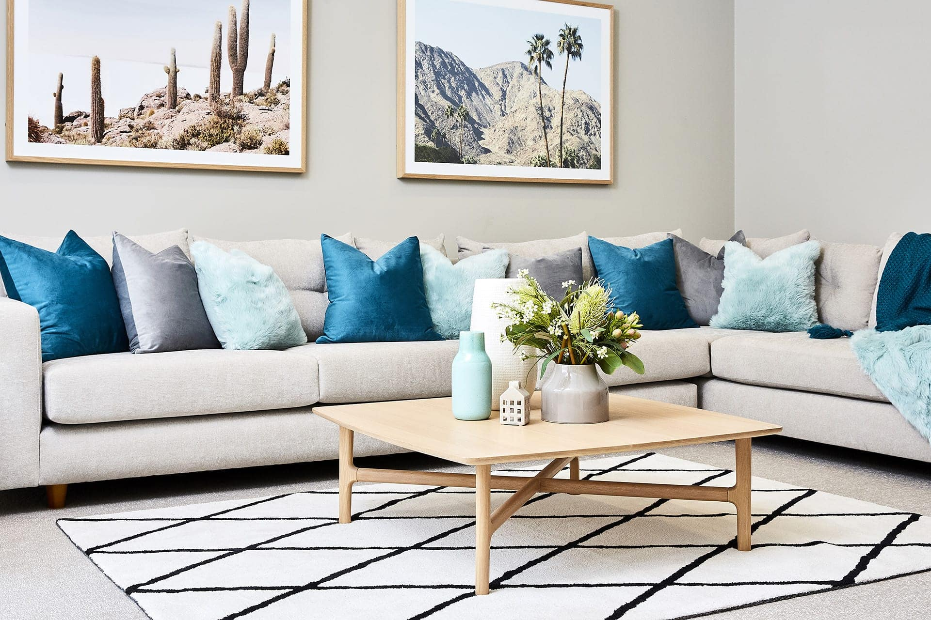 lorraine lea teal and mint cushions on sofa for spring decorating ideas from tlc interiors