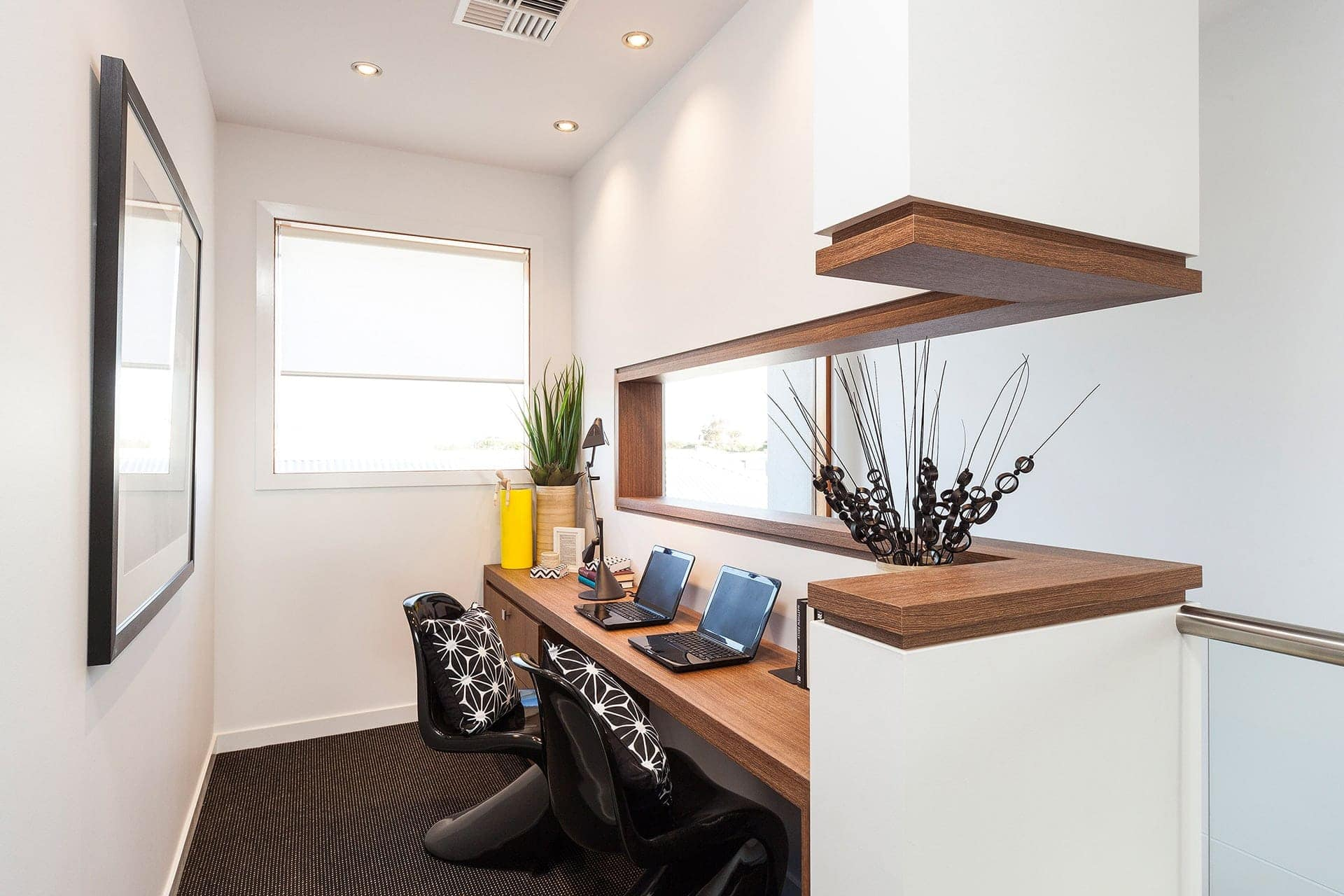 built in study nook home office zone at top of stairs in metricon display home