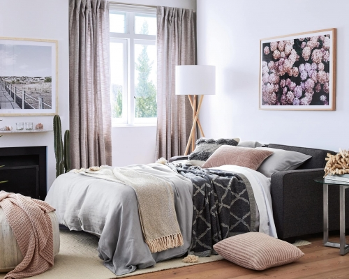 guest bedroom decorating ideas grey sofabed from freedom with pink artwork