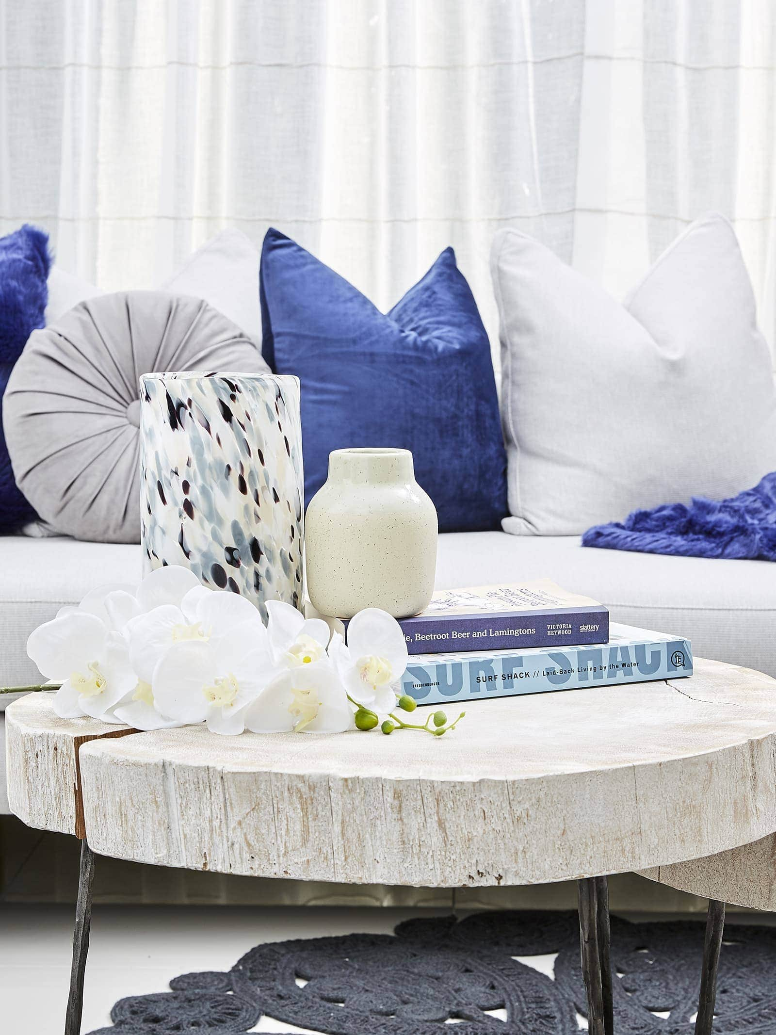 navy blue sofa styling ideas using lorraine lea cushions and throws