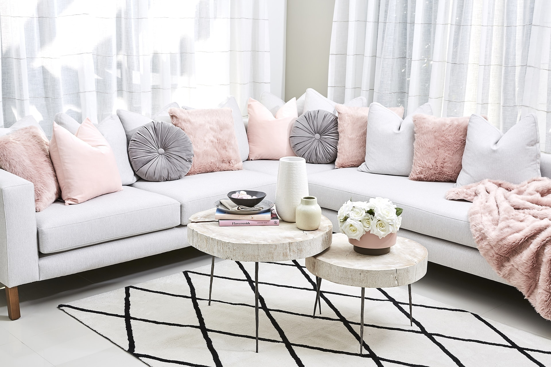 pink and grey sofa styling ideas using lorraine lea cushions and throws