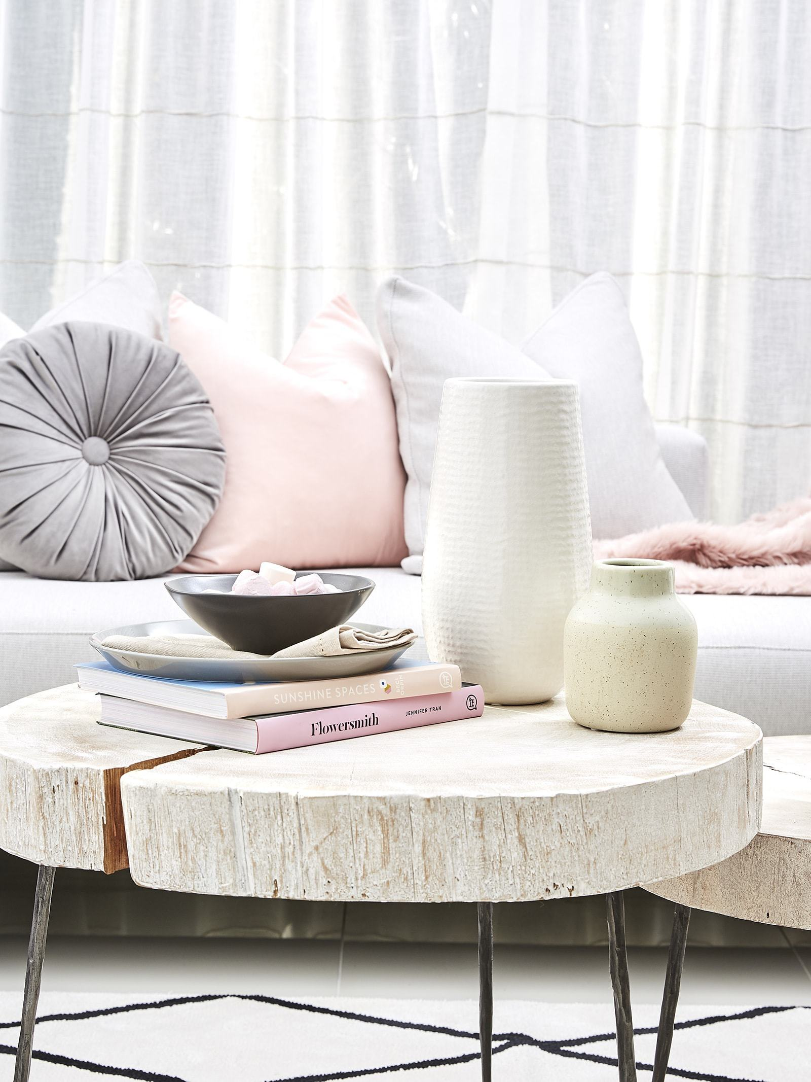 pink sofa styling ideas pink and grey cushions and vase in living room