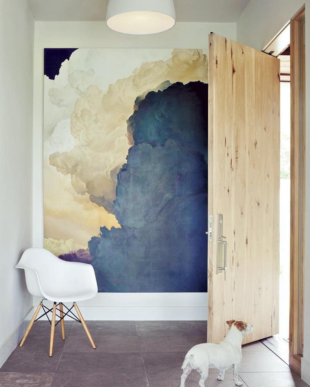 large artwork inside front door decorating a small entryway
