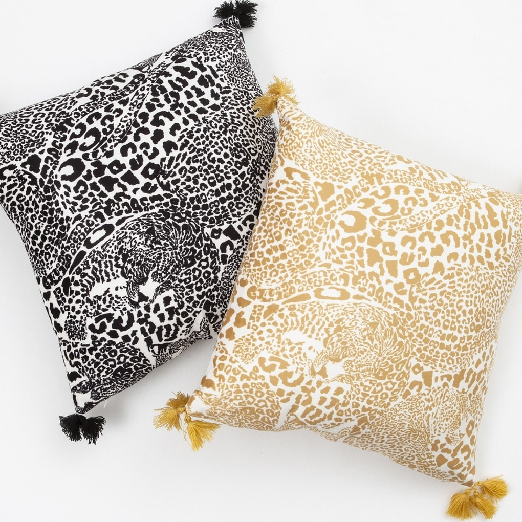 black and gold animal print cushions with tassels