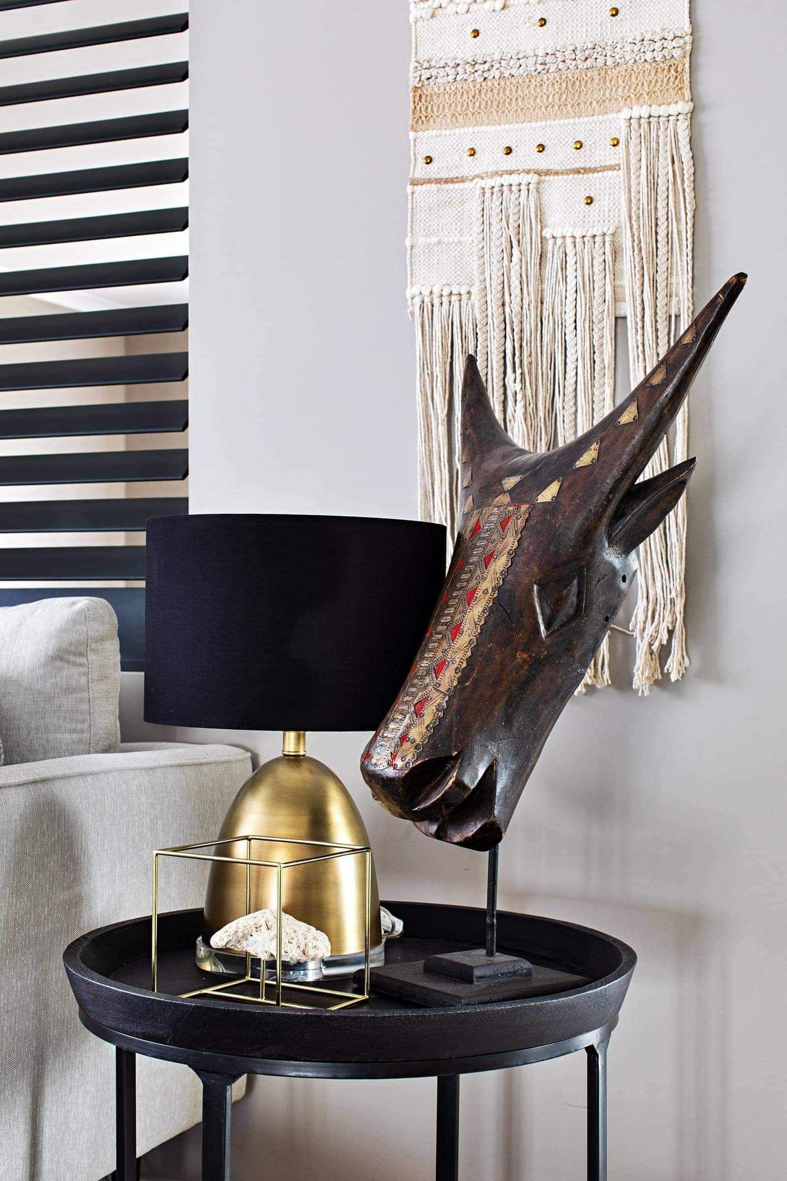dark bohemian interior design animal head ornament on black side table