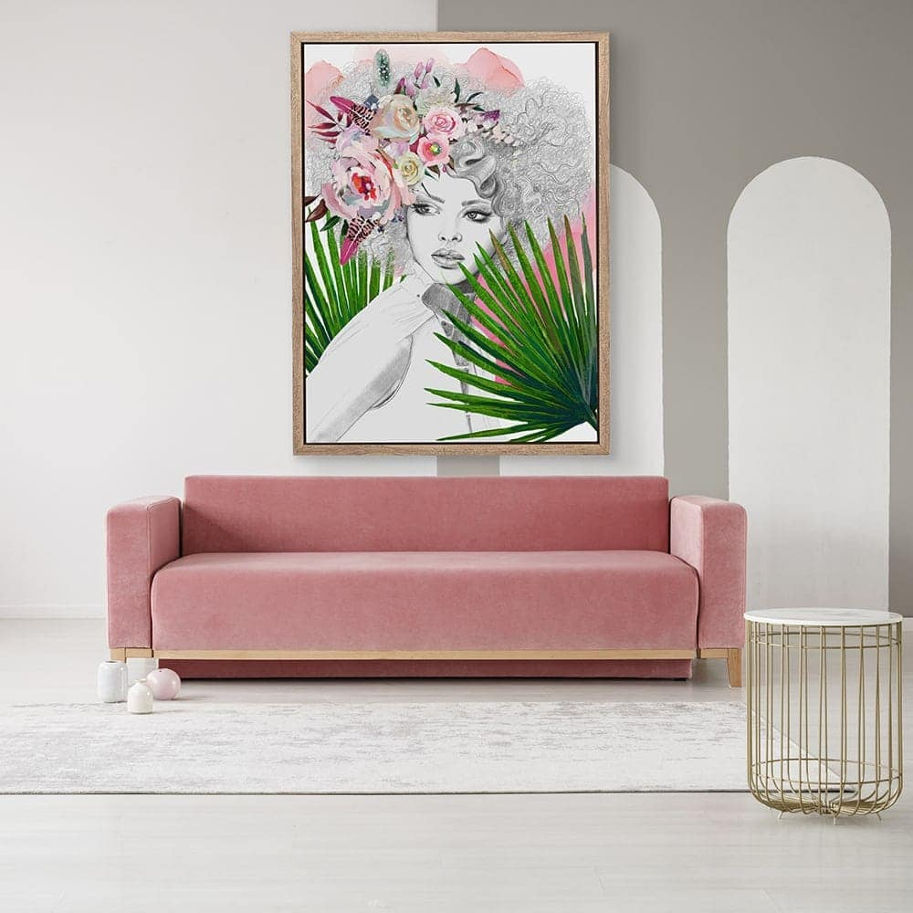 feminine floral art in living room with pink velvet sofa and gold side table