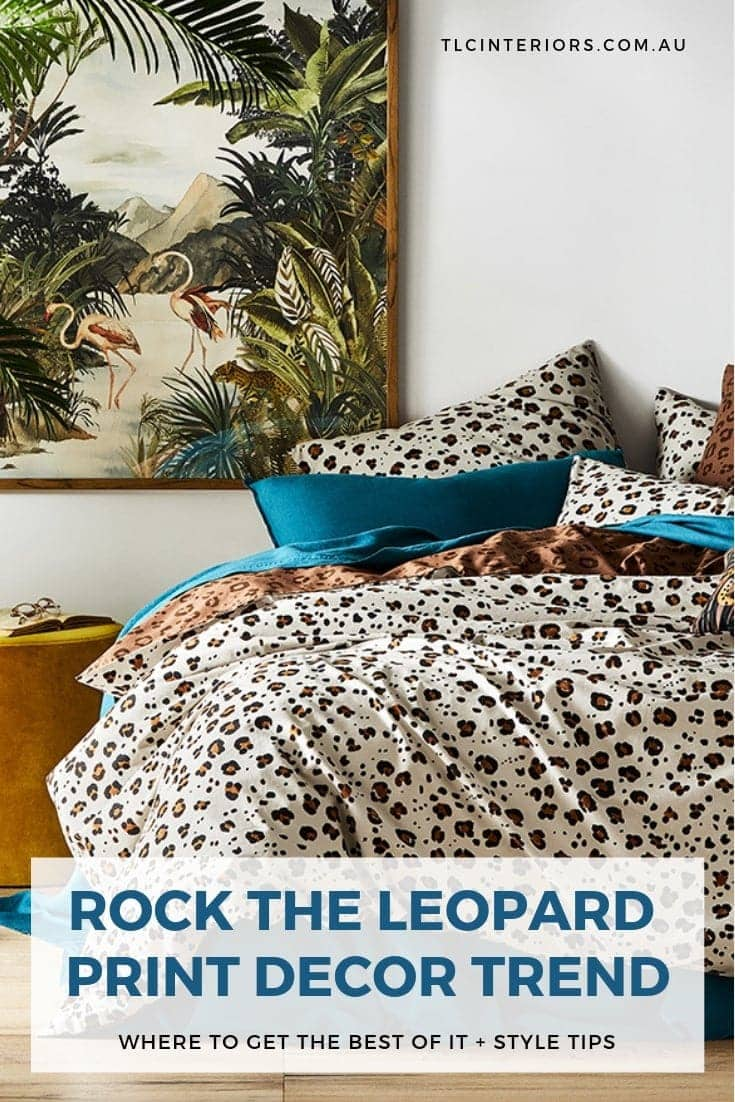 leopard print bedding in bedroom with jungle artwork and mustard ottoman