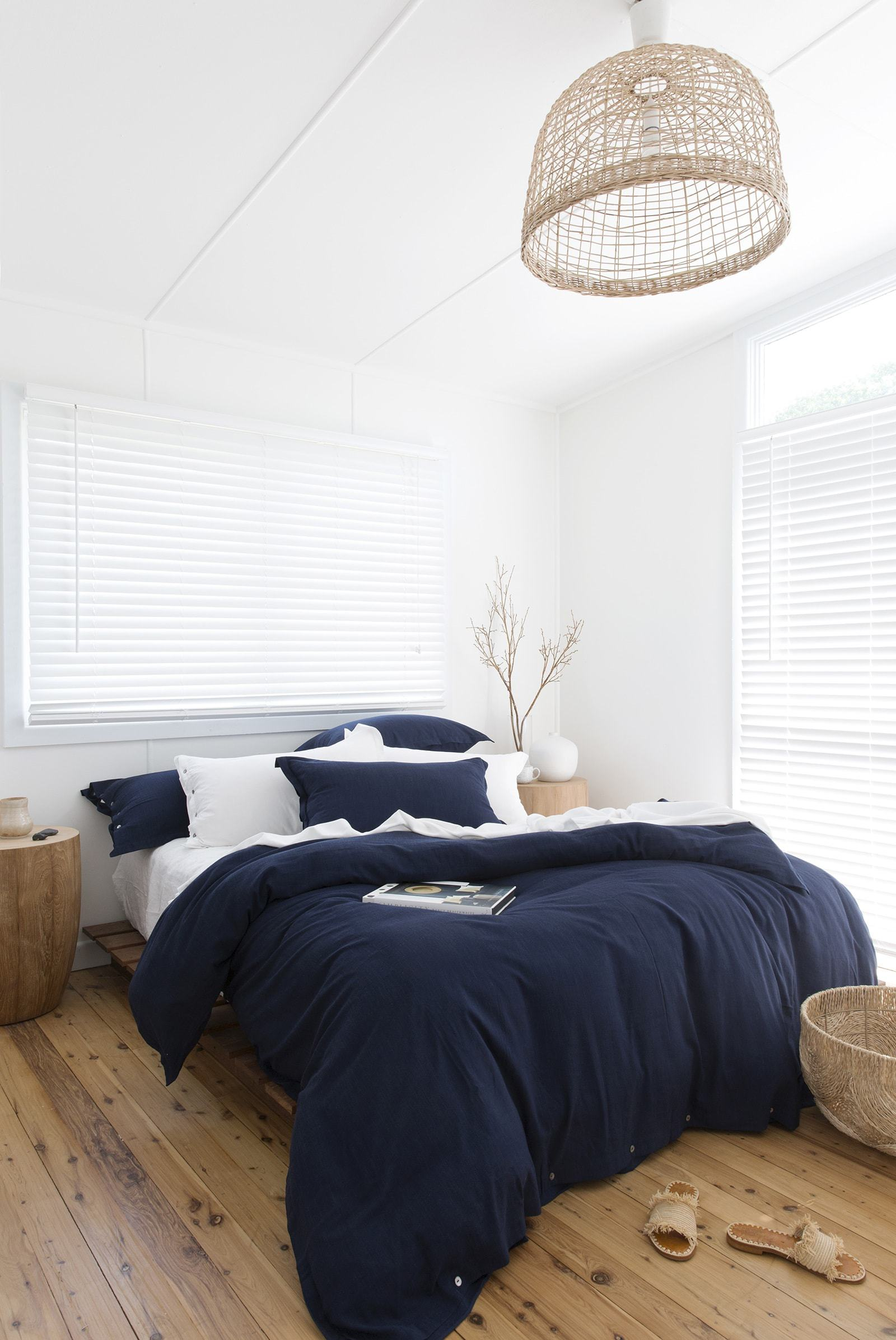 loom living navy blue bamboo quilt cover set in bedroom with timber floors