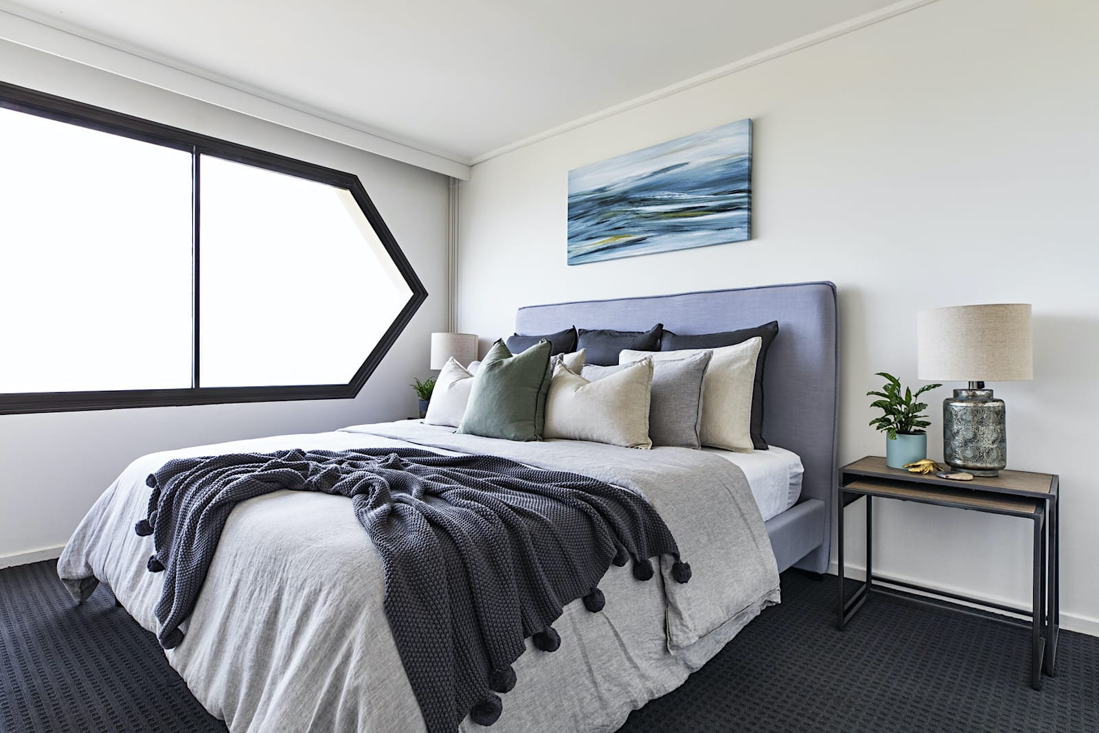 coastal bedroom design with soft grey linen bedding from adairs and abstract coastal art above bed