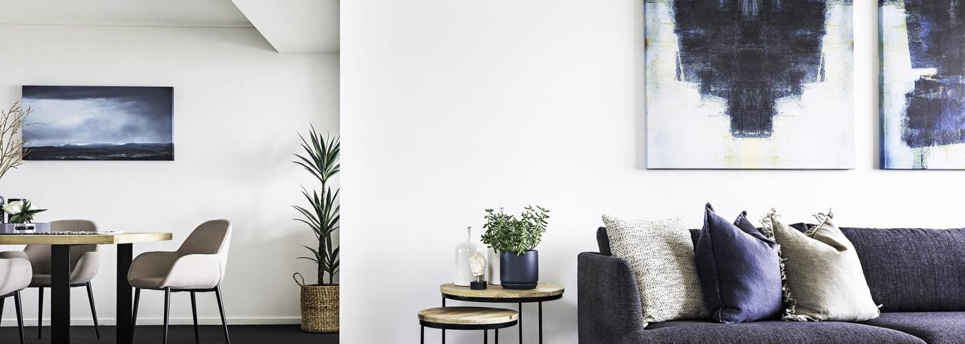 dark coastal interior design living room and dining room by tlc interiors