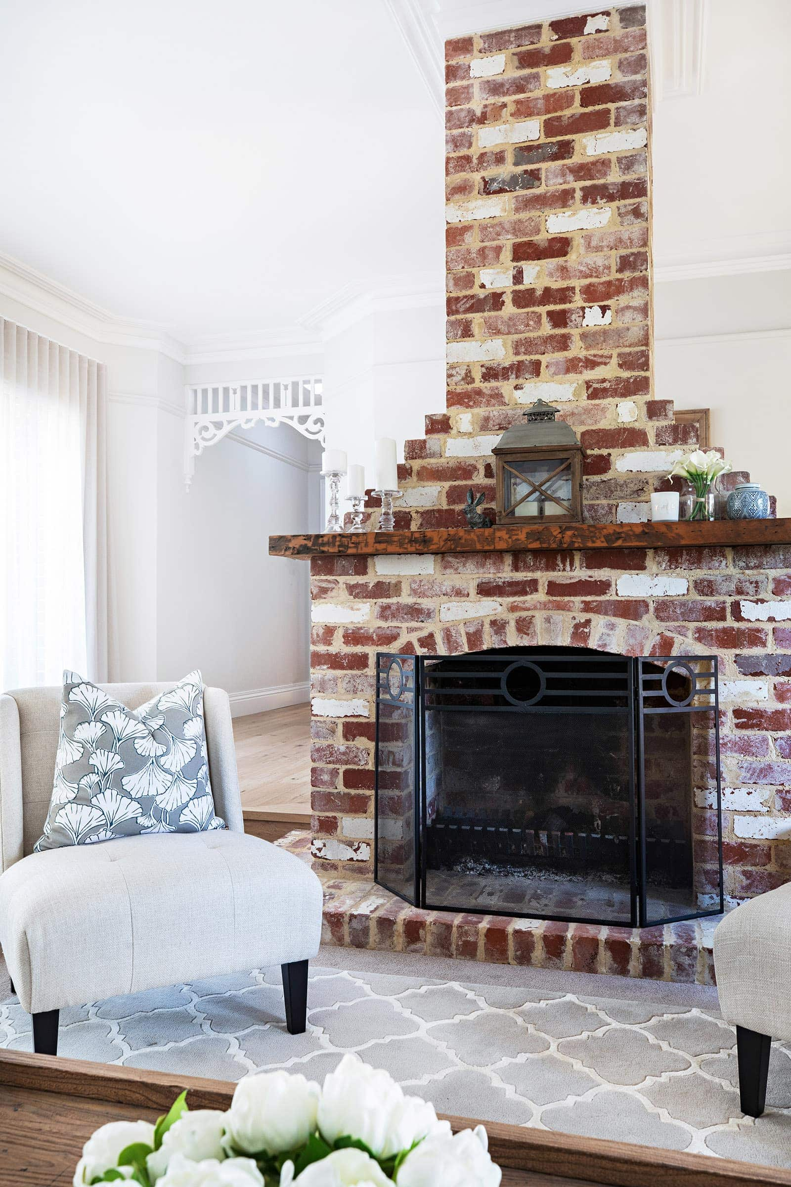 brick fireplace in modern provincial sitting room by melbourne interior designer chris carroll