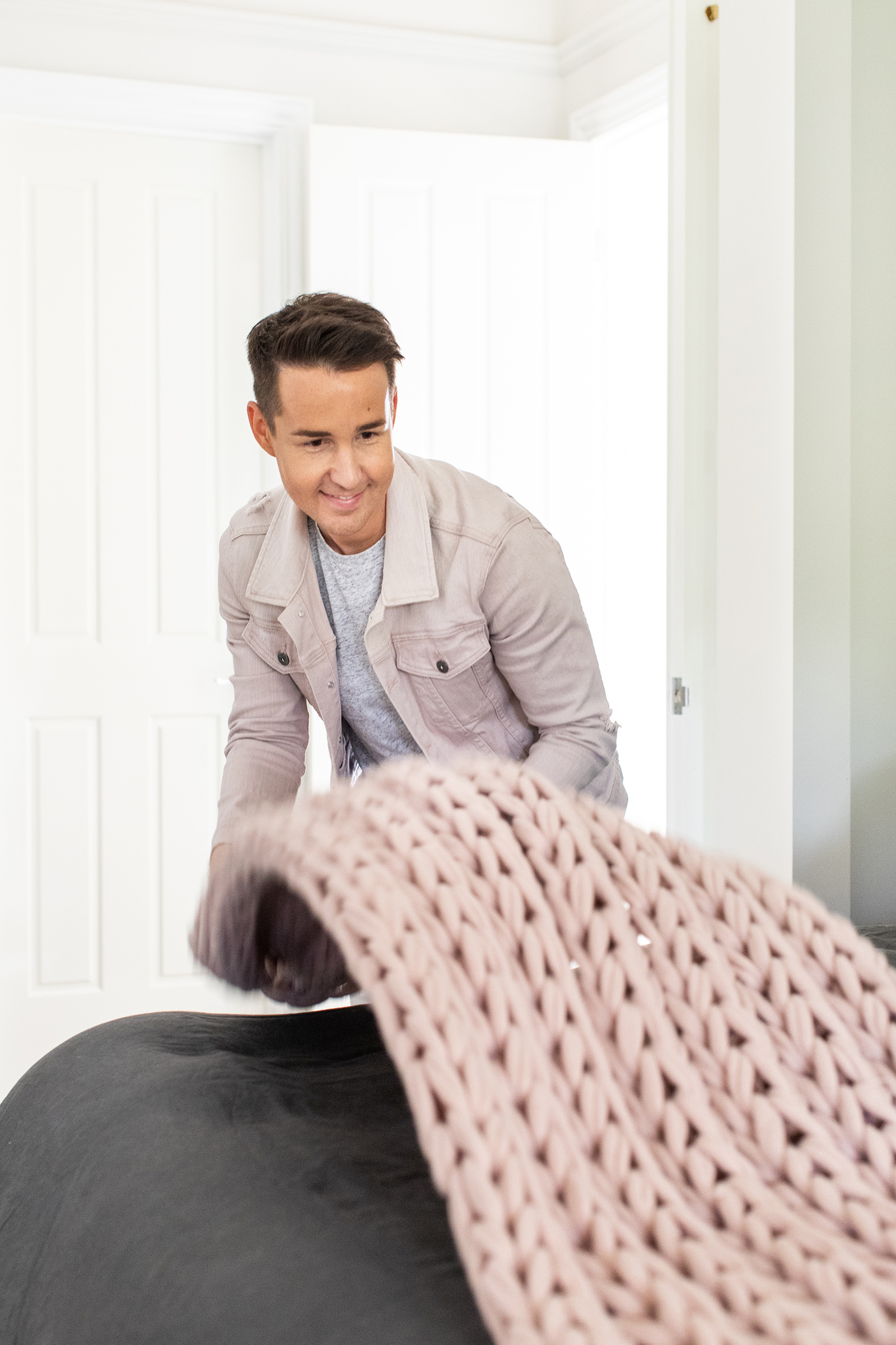 chris carroll tlc interiors melbourne interior designers chris bed styling with pink cable knit throw