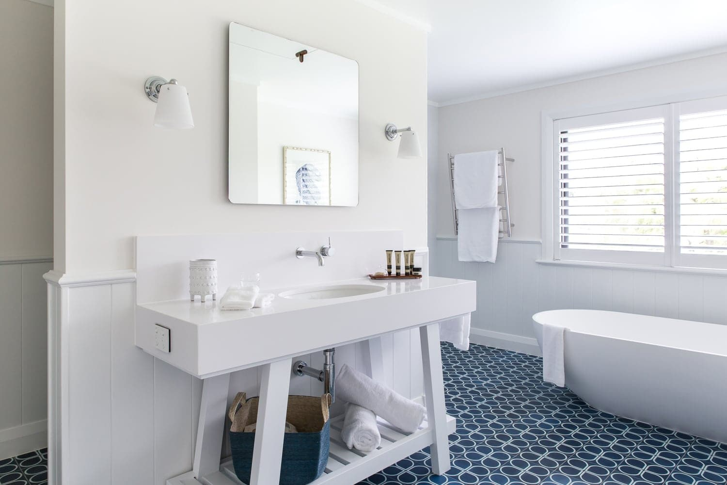 hamptons style bathroom with white timber vanity and blue and white floor tiles bendooley estate