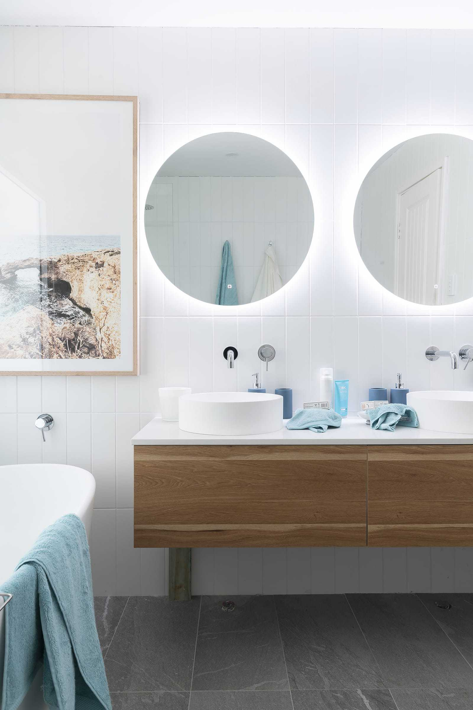 house rules 2019 eliza and mikaela bathroom with round mirror and floating timber vanity