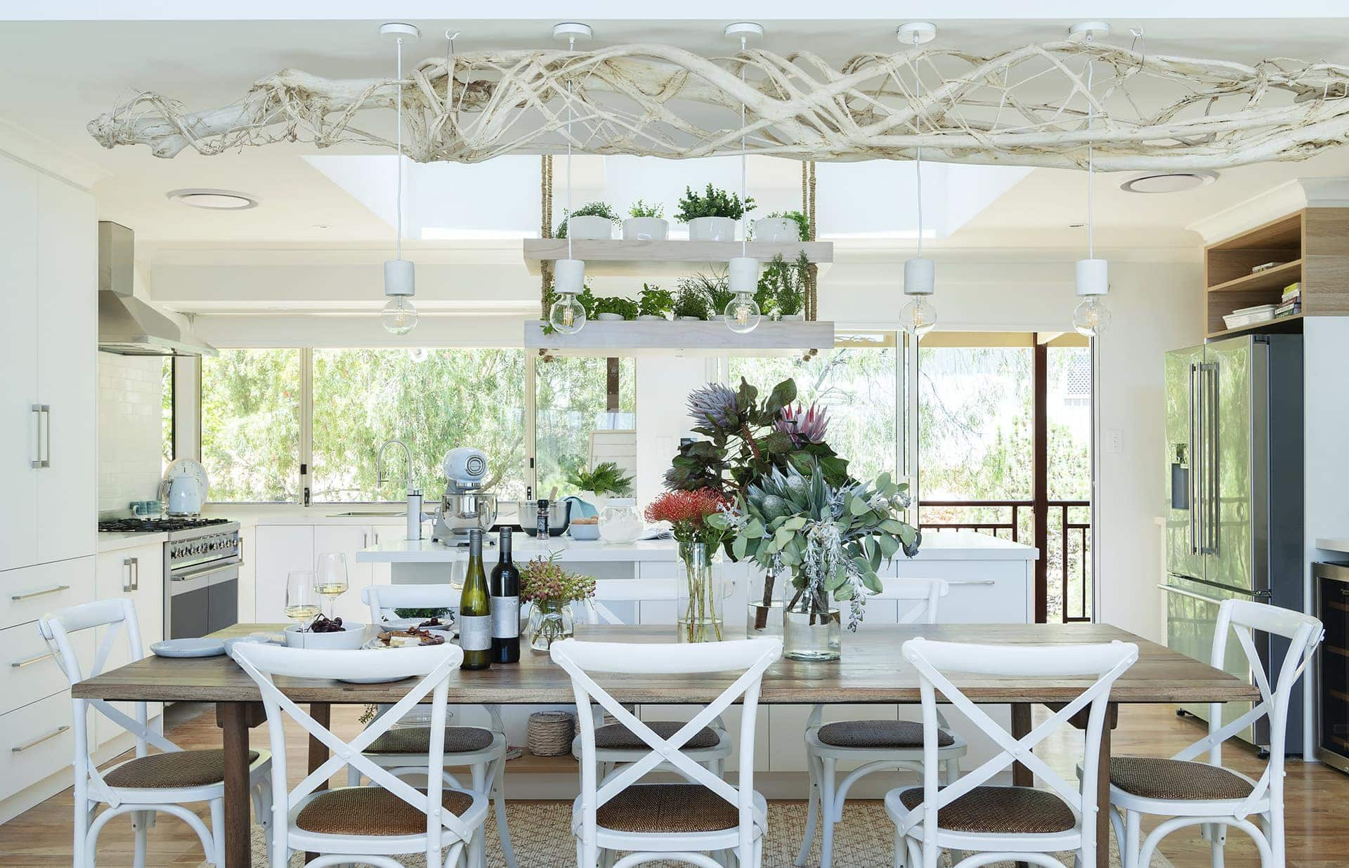 house rules 2019 eliza and mikaela dining room with white hamptons dining chairs