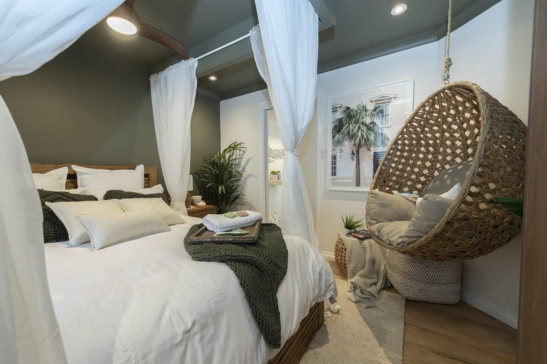 house rules 2019 eliza and mikaela green tropical bedroom with hanging chair and four poster bed