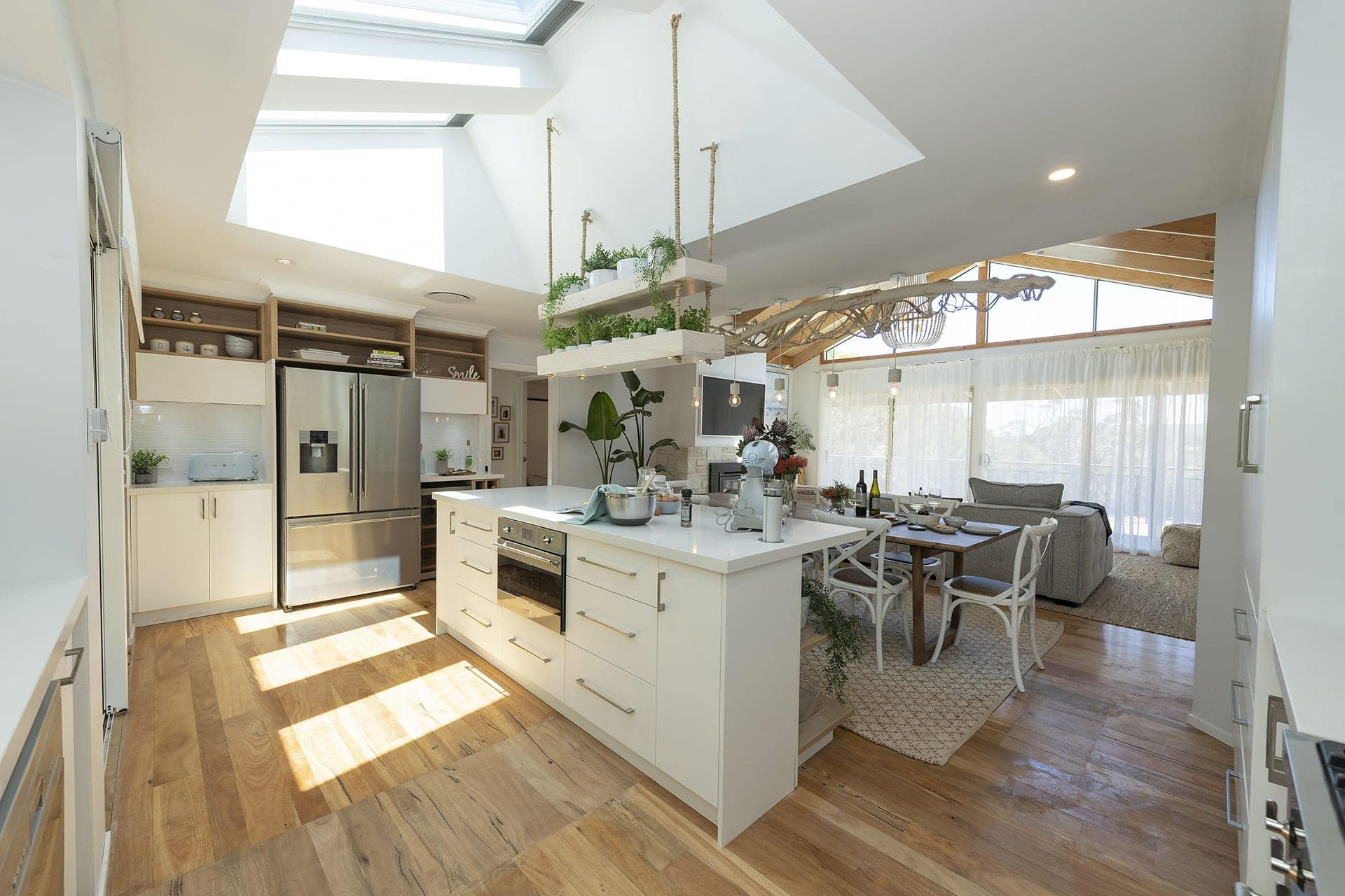 house rules 2019 eliza and mikaela kitchen with large skylight and suspended herb garden