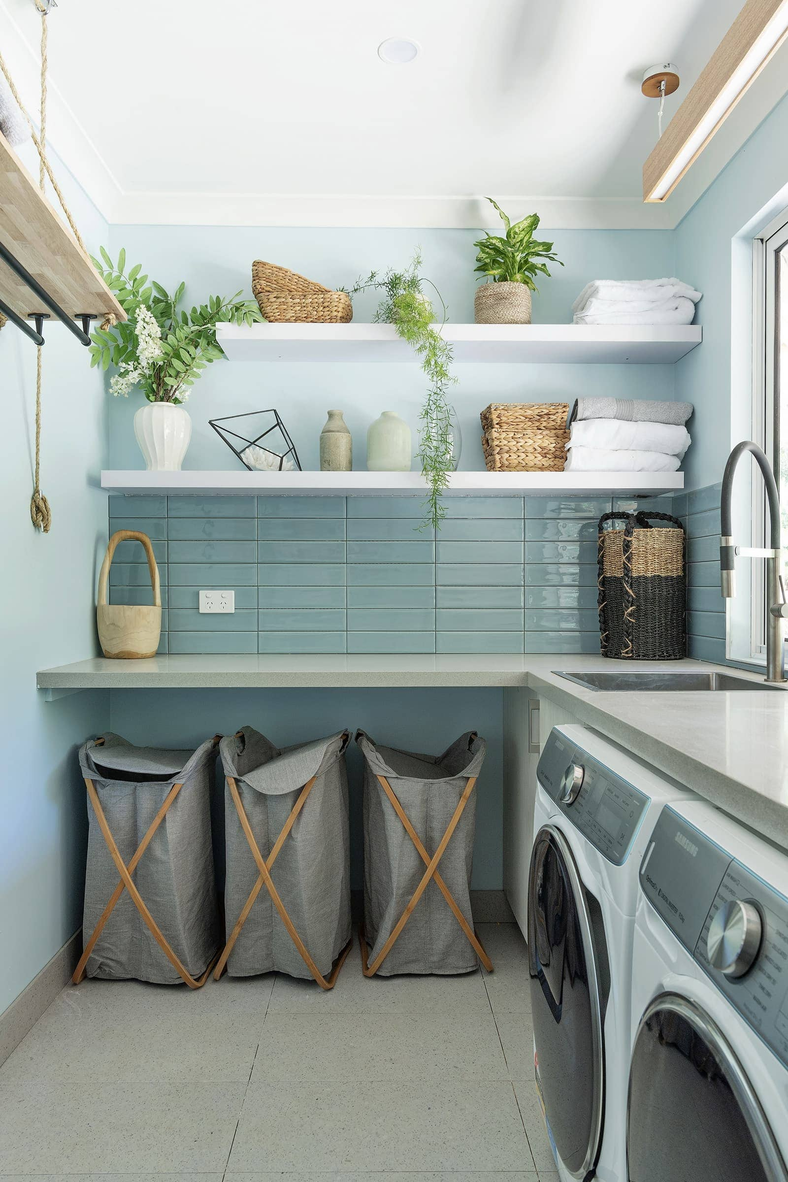 house rules 2019 eliza and mikaela laundry with blue walls and blue glaze wall tiles