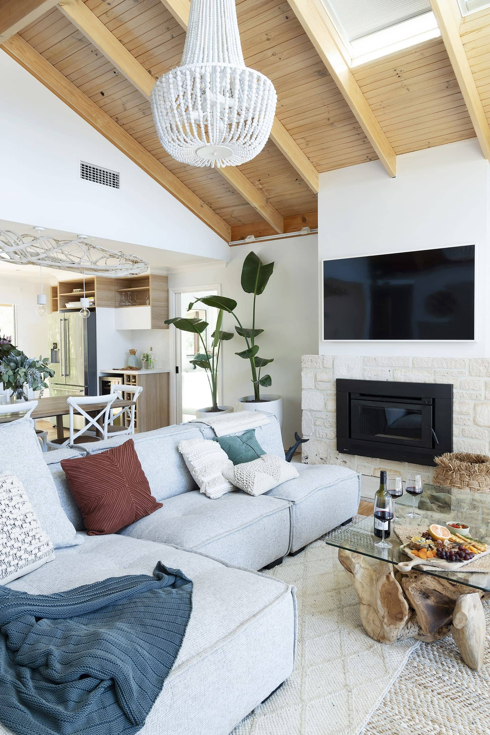 house rules 2019 eliza and mikaela living room with white clay pendant and brick fireplace