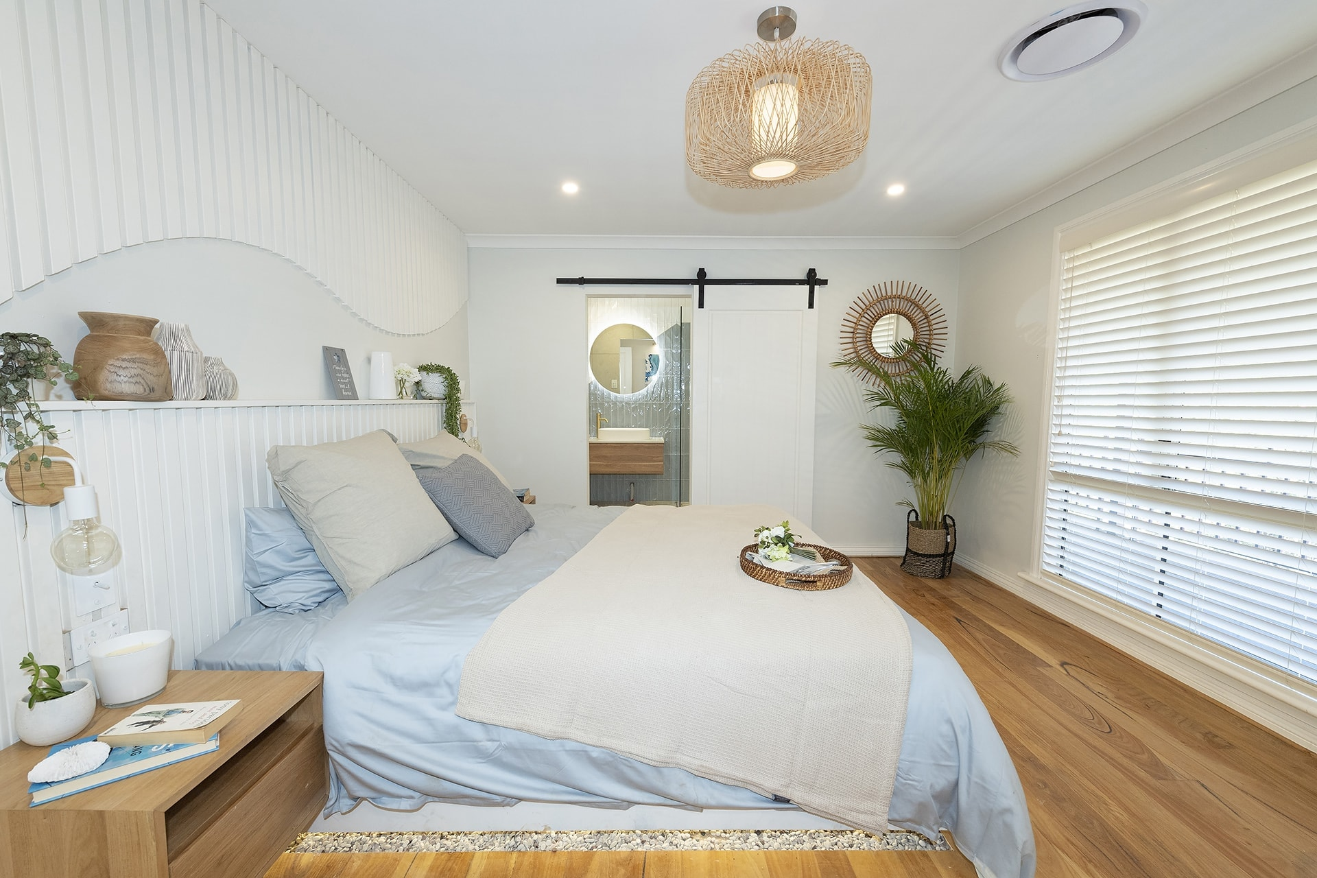 house rules 2019 eliza and mikaela master bedroom with pebble floor feature