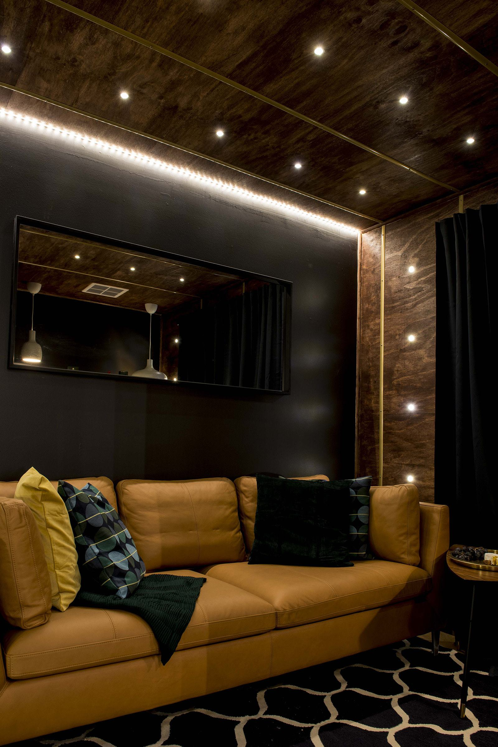 house rules 2019 lisa and andy den tan leather sofa in black room