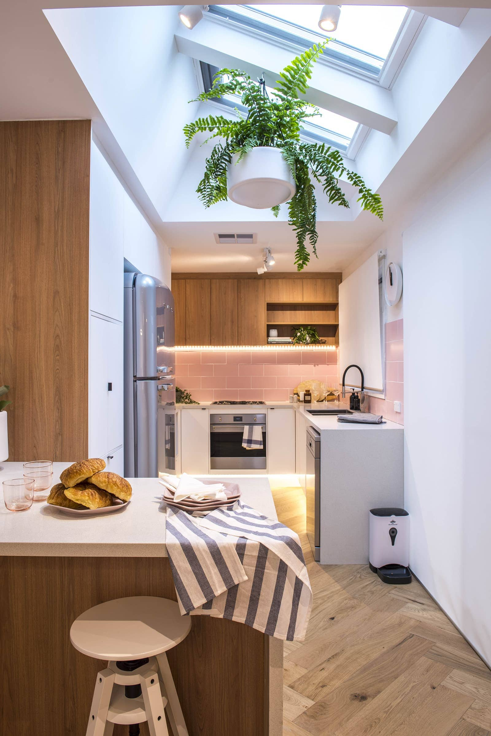 house rules 2019 lisa and andy scandi style kitchenw with pink splashback tiles