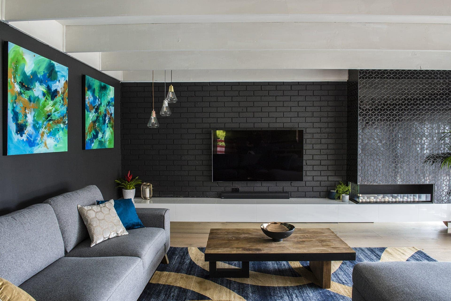 house rules 2019 pete and courtney living room black brick wall in living room with tiled feature wall