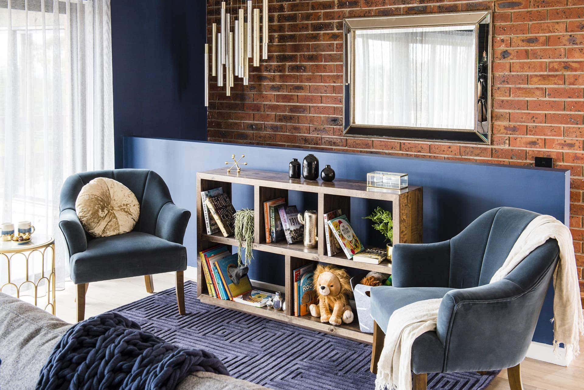 house rules 2019 pete and courtney red brick living room with blue feature wall