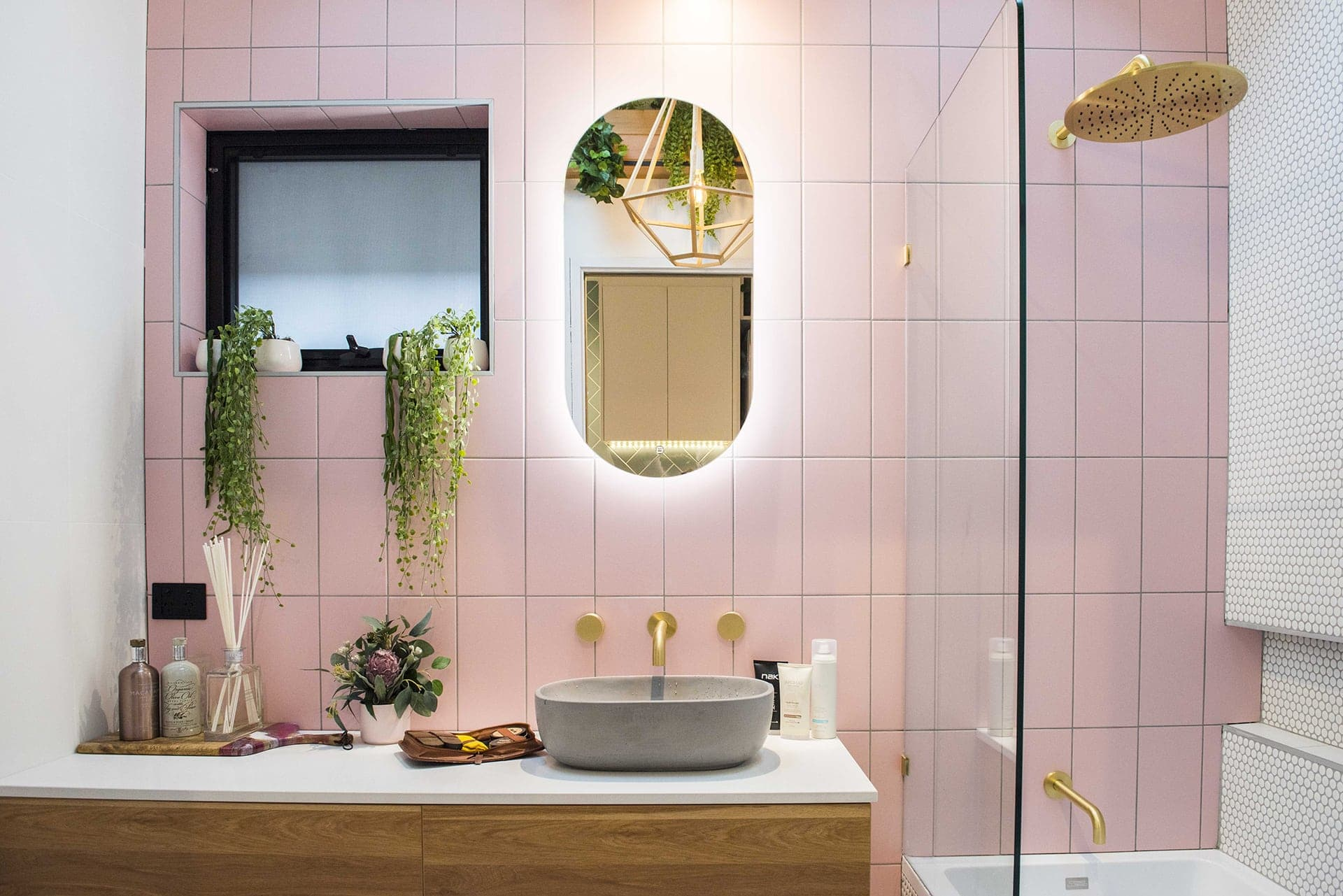 house rules 2019 pink bathroom with floating vanity and gold tapware