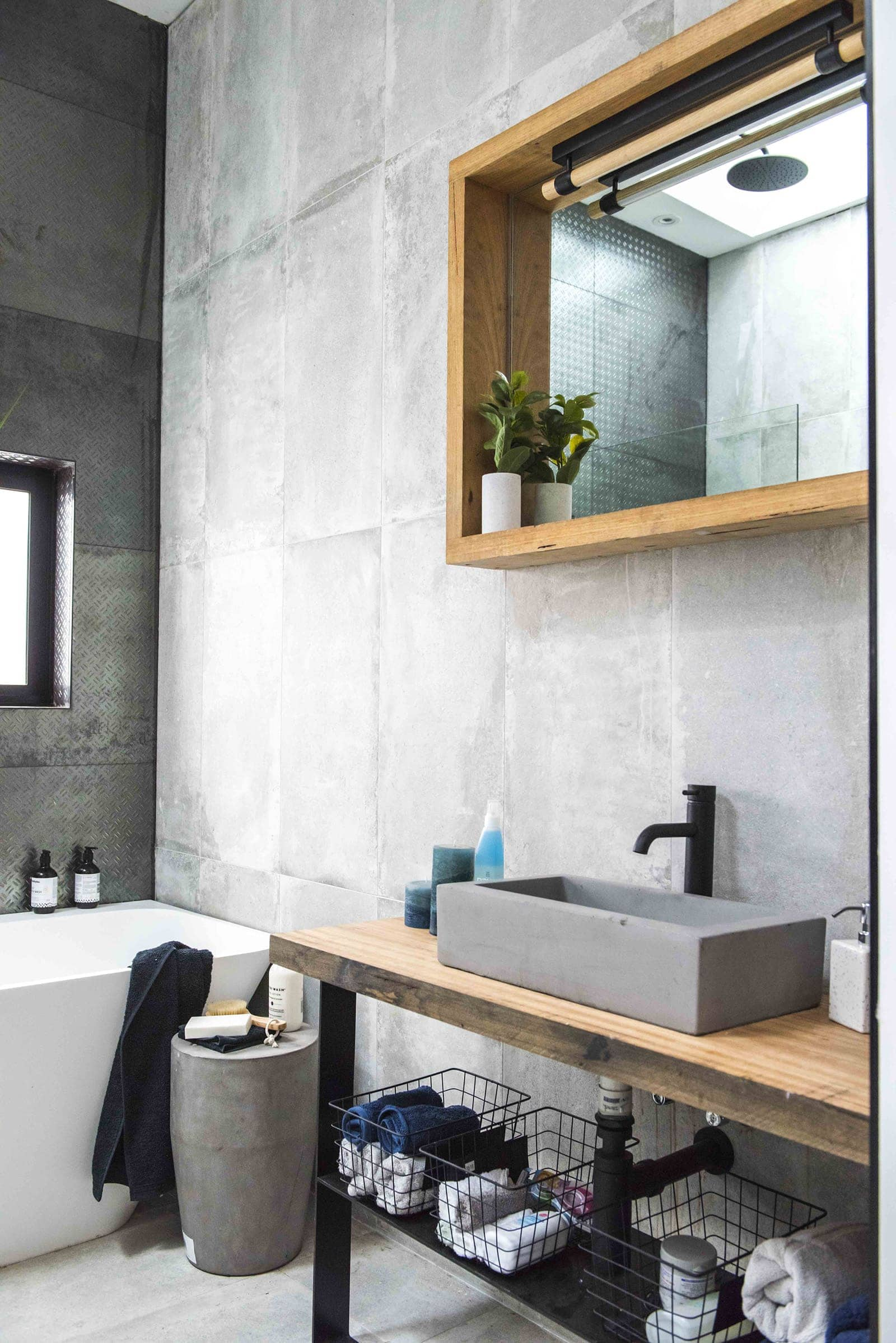house rules 2019 tim and matt bathroom with concrete wall and industrial vanity