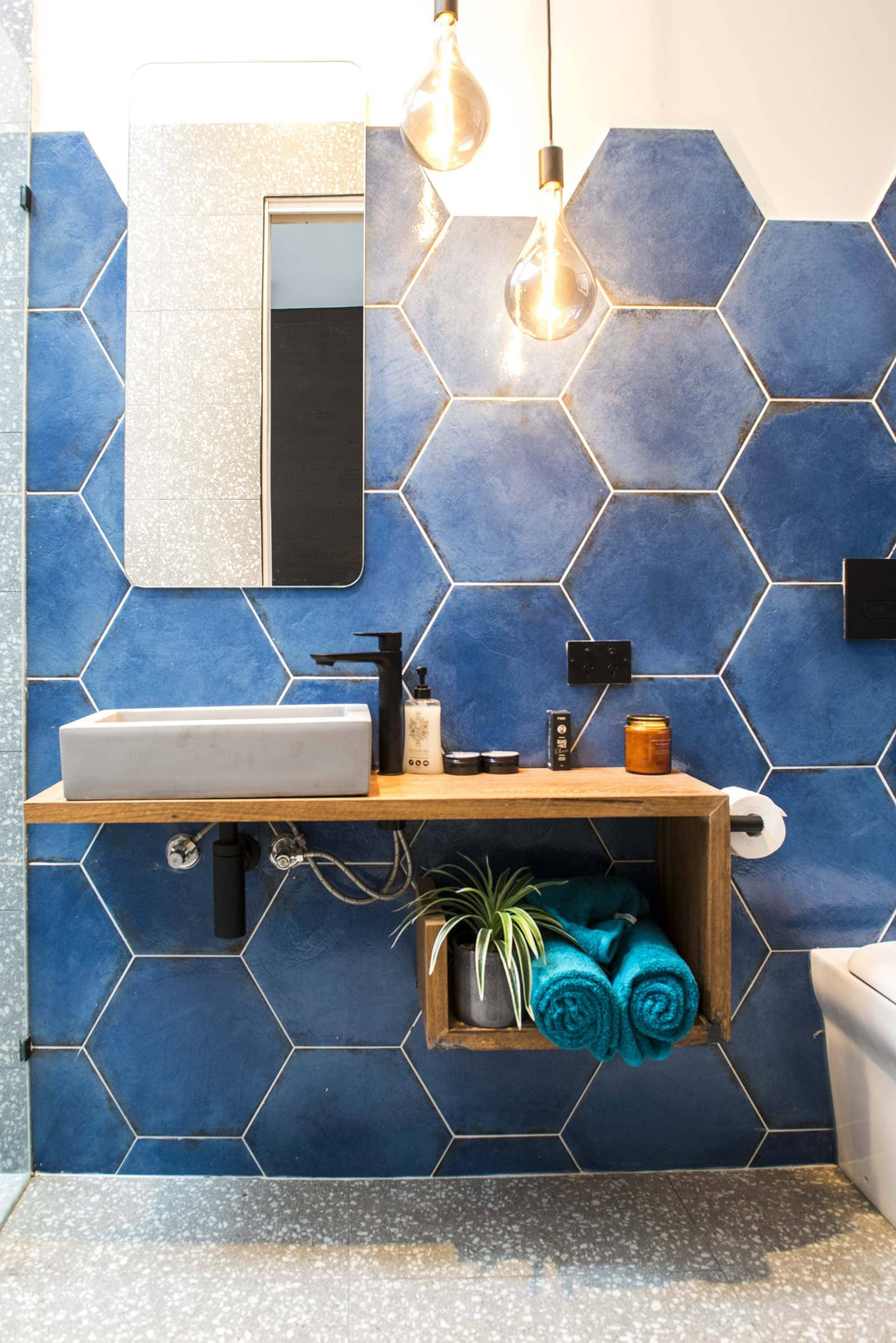 house rules 2019 tim and matt ensuite with blue hexagon tiles and floating vanity