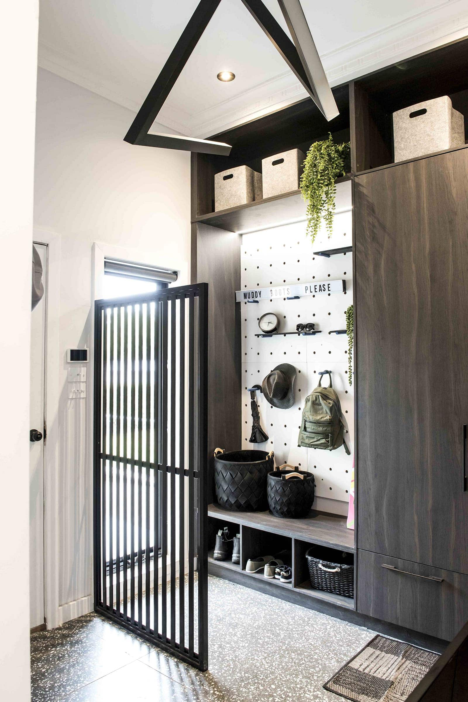house rules 2019 tim and matt entryway with black built in cabinetry