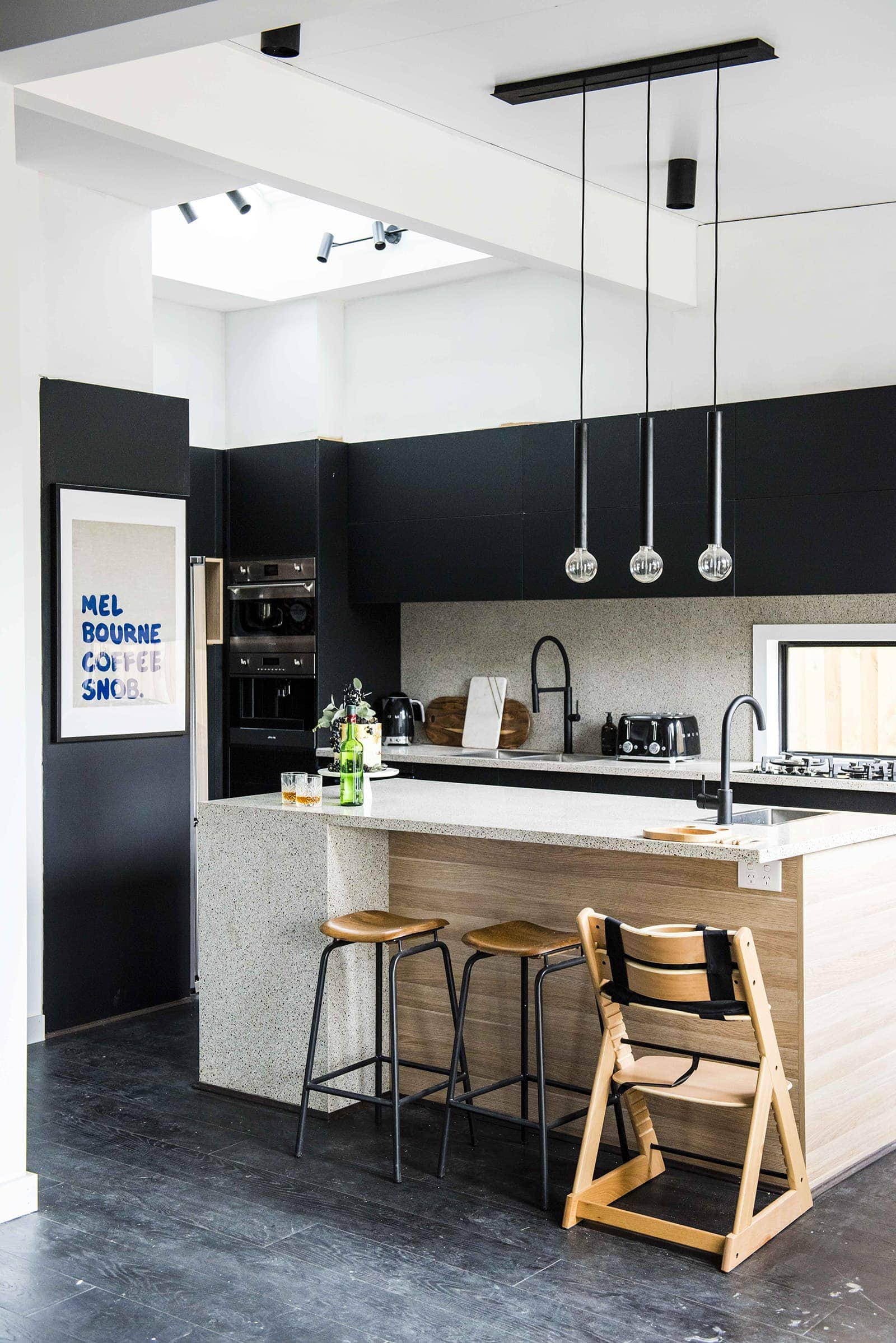 house rules 2019 tim and matt industrial kitchen with black cabinetry