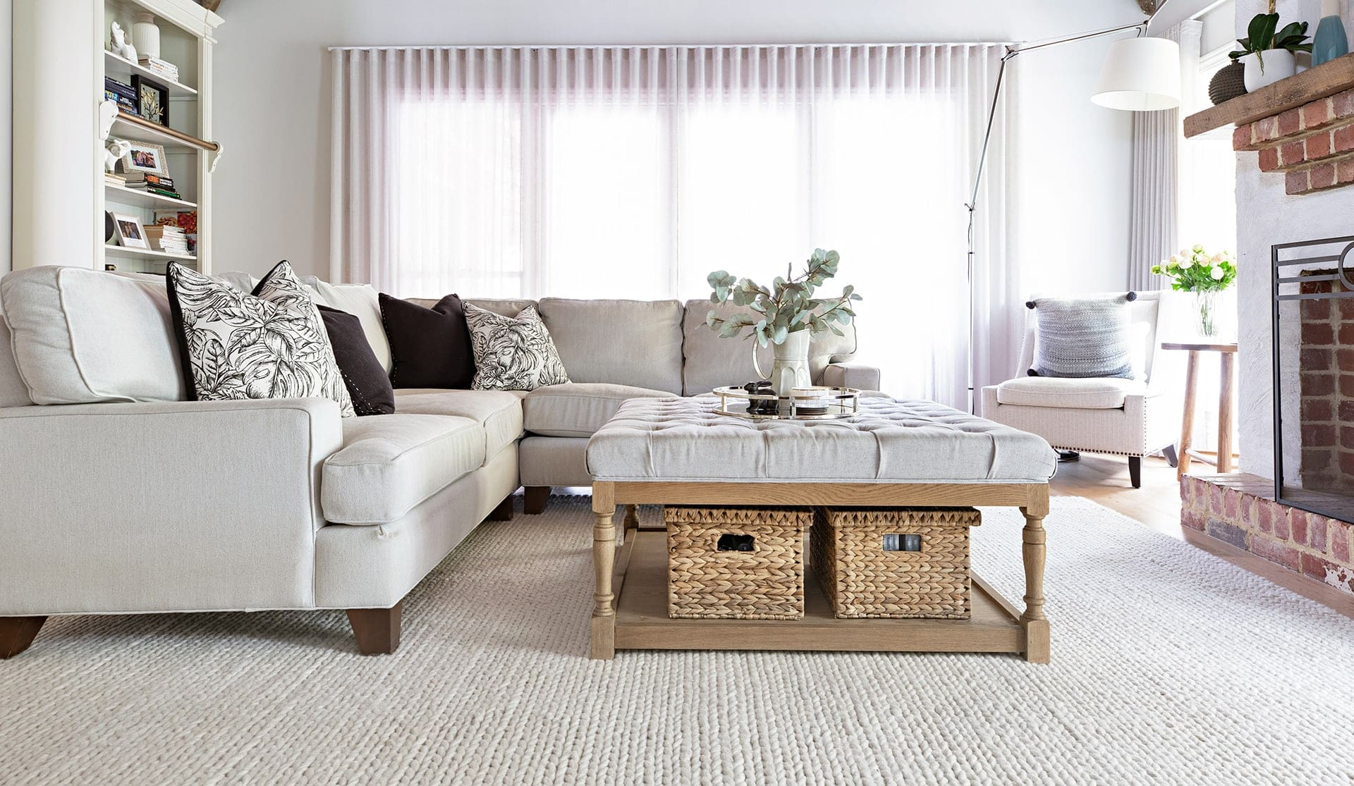 modern provincial living room with beige sectional sofa and sheer curtains