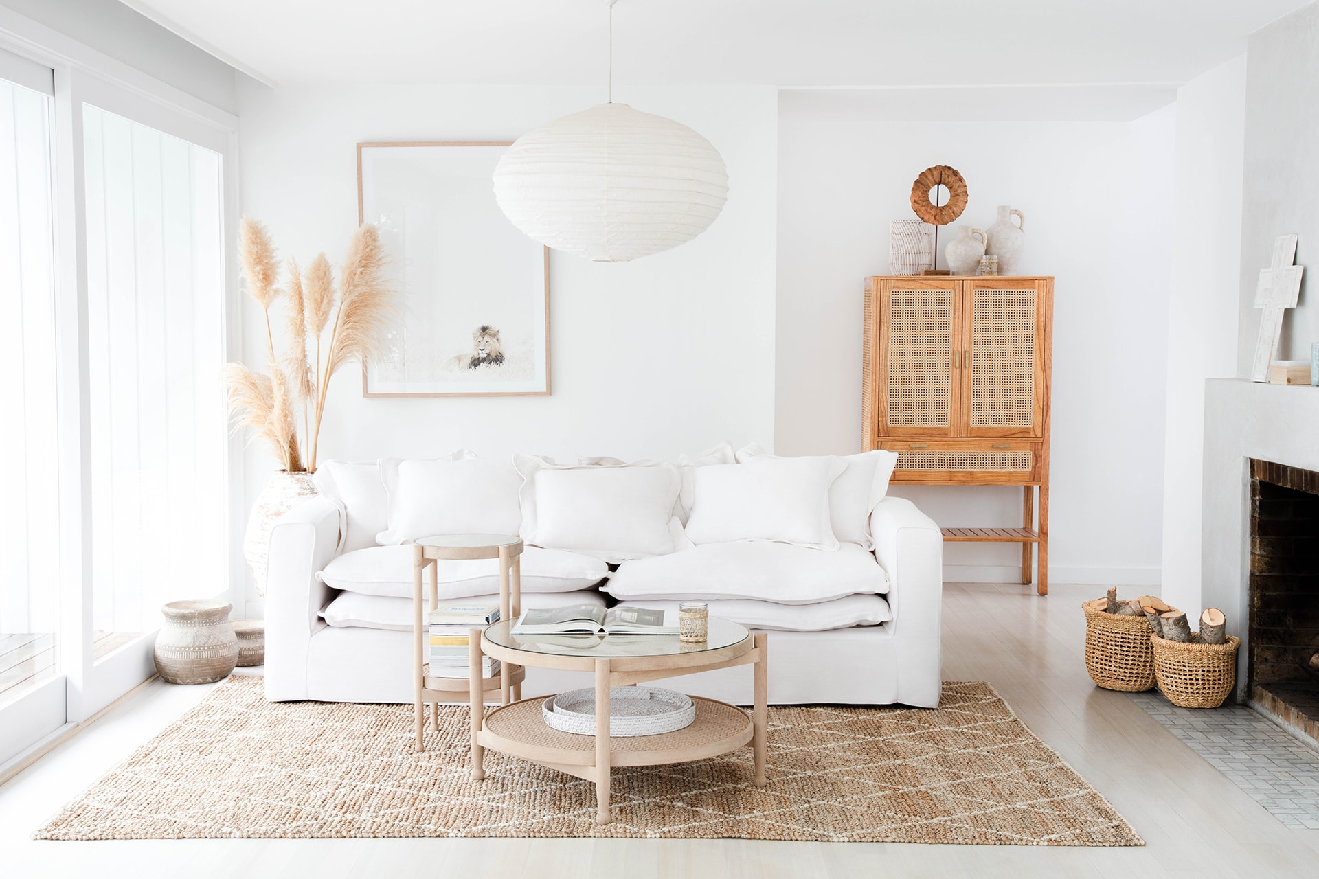 all white coastal living room with oz design white coastal sofa and jute rug
