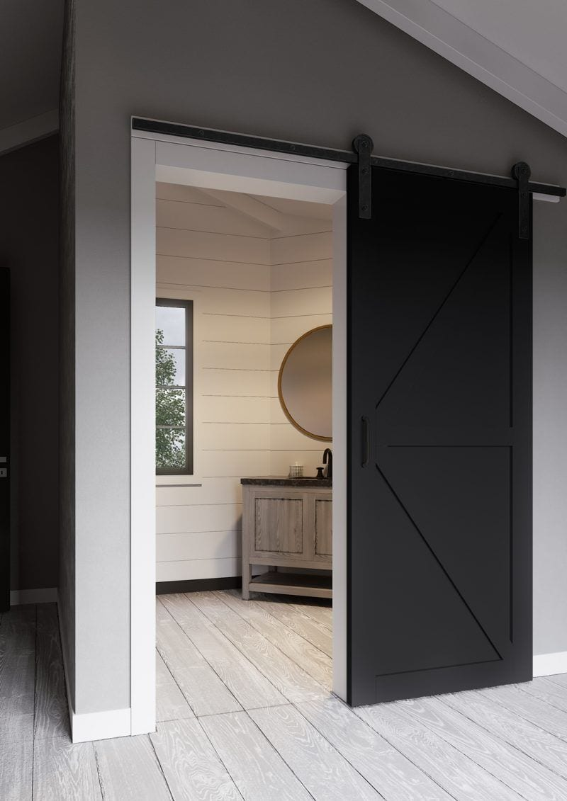 black barn sliding door in roomw ith grey walls