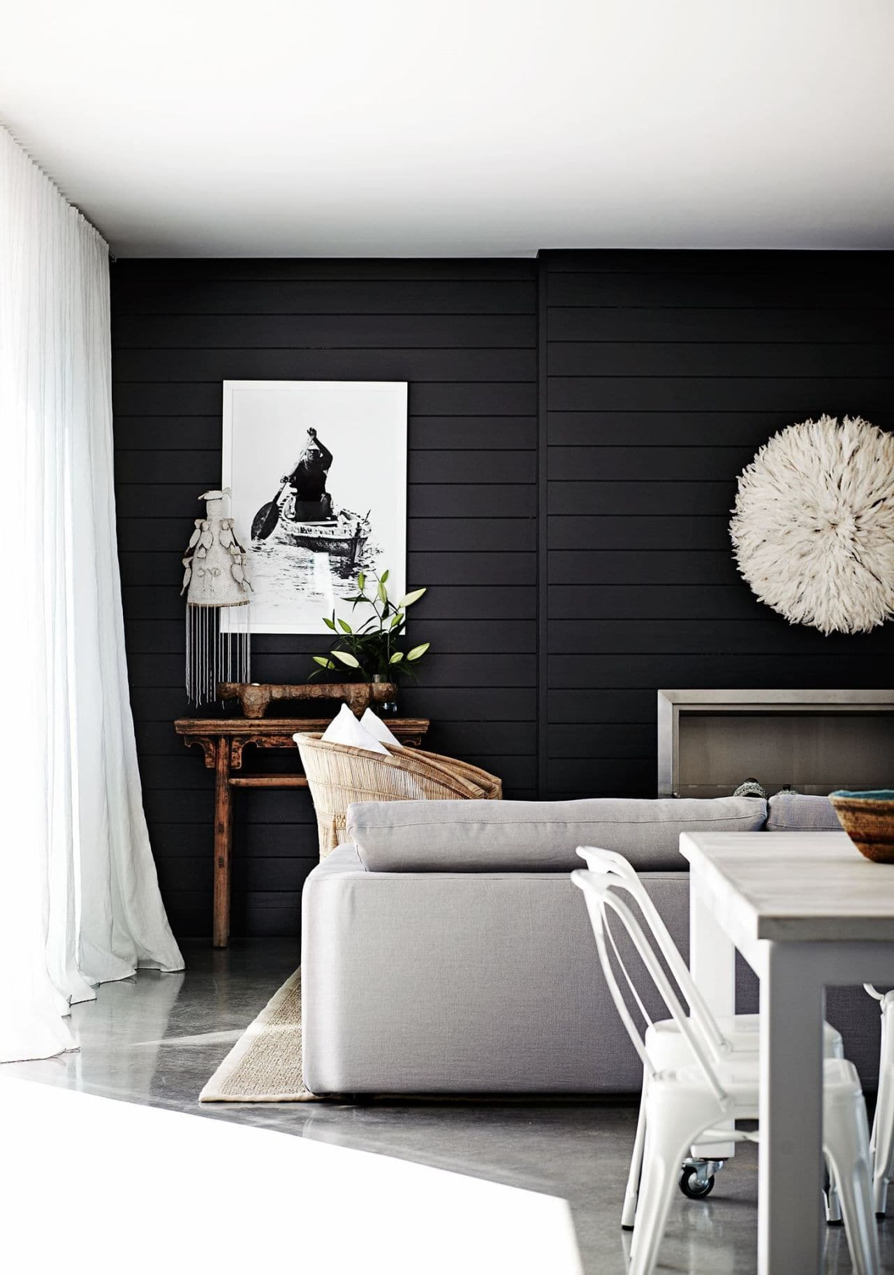 black tongue and groove wall panelling in boho living room