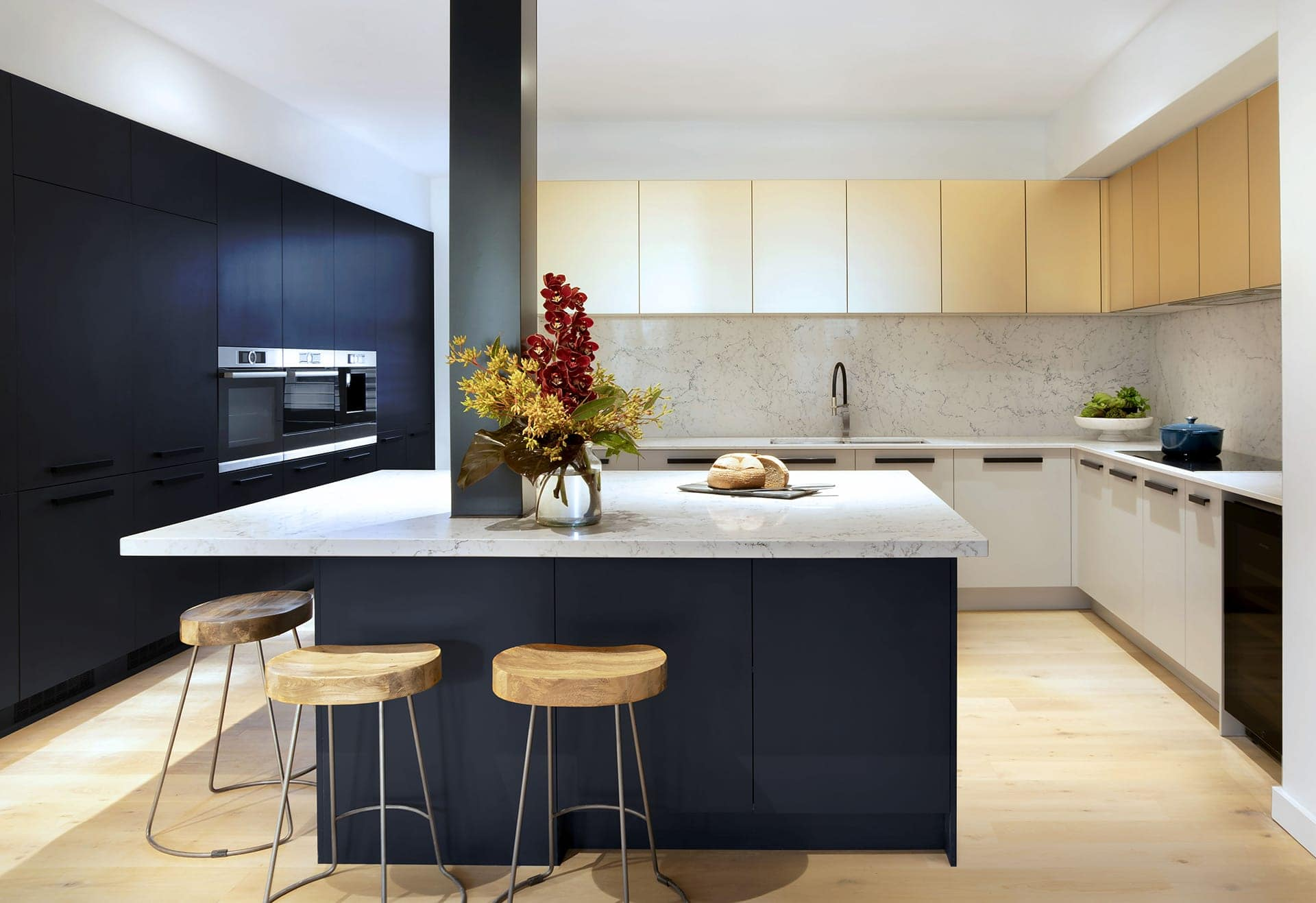 gold kitchen cabinets mixed with navy blue kitchen cabinets by freedom kitchens the block