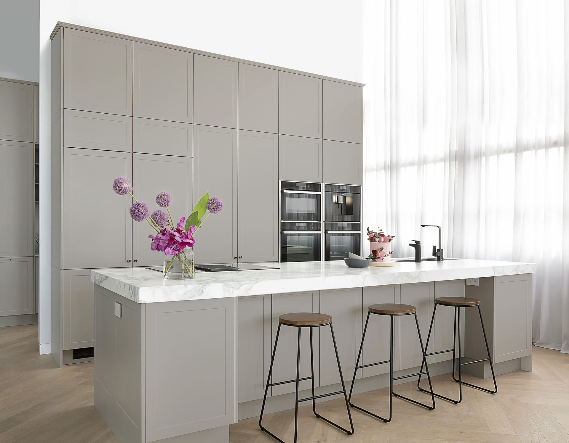 grey shaker kitchen cabinets with thick white marble benchtop freedom kitchens the block