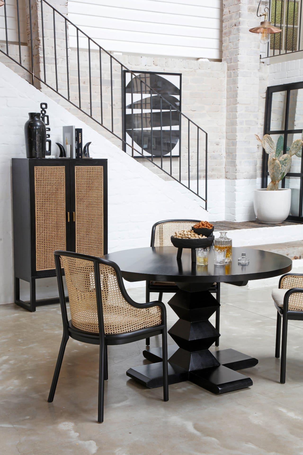 oz design dining room furniture with rattan storage cabinet and round black dining table