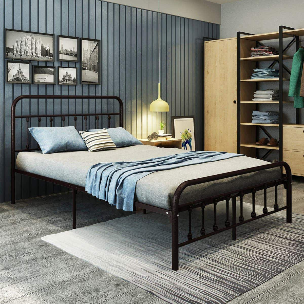 vintage black metal bed frame in teenage boys room with blue wallpaper and striped rug