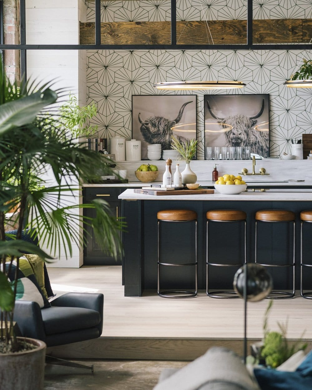 inside the queer eye apartment black kitchen counter and leather stools