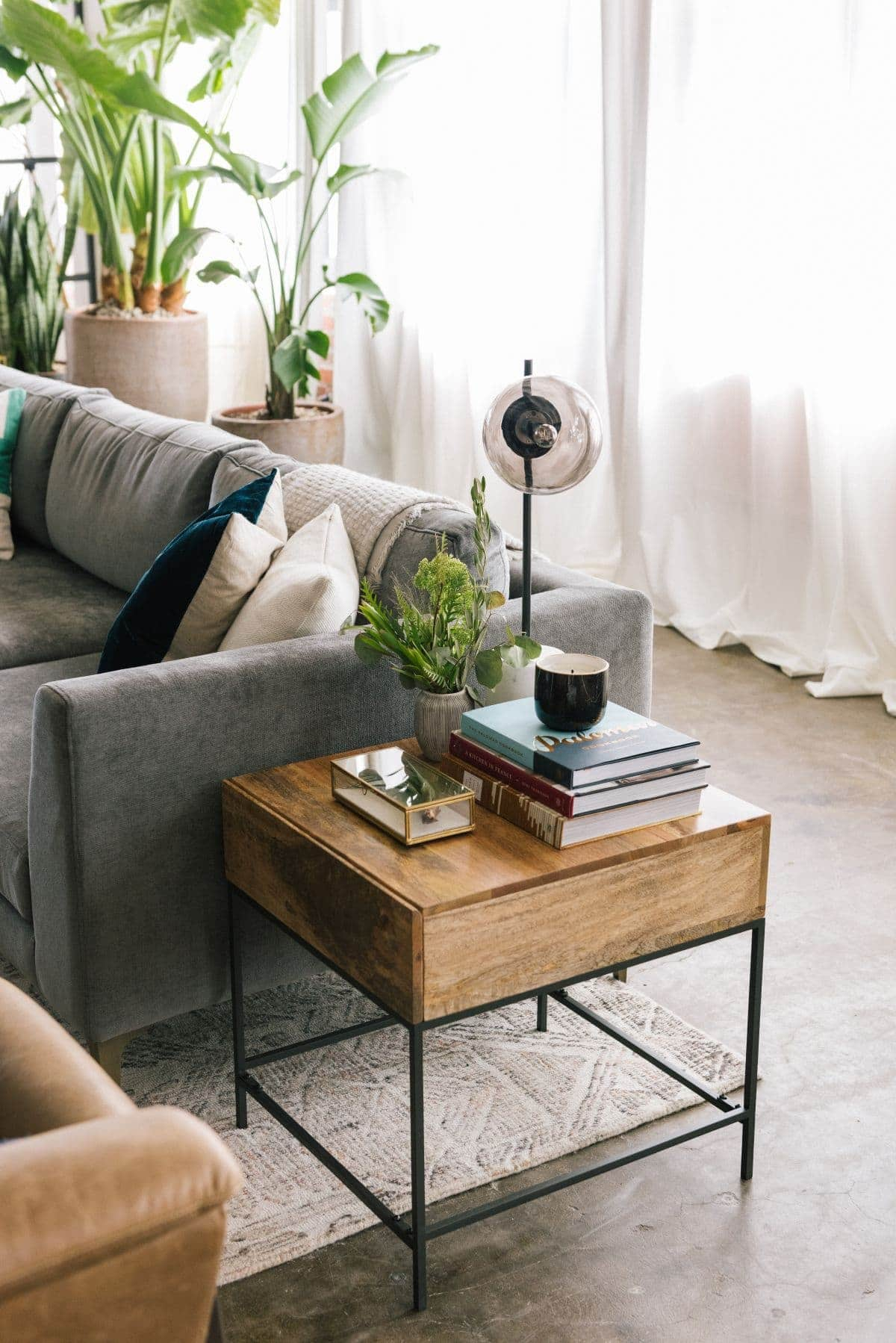 inside the queer eye apartment timber side table from west elm