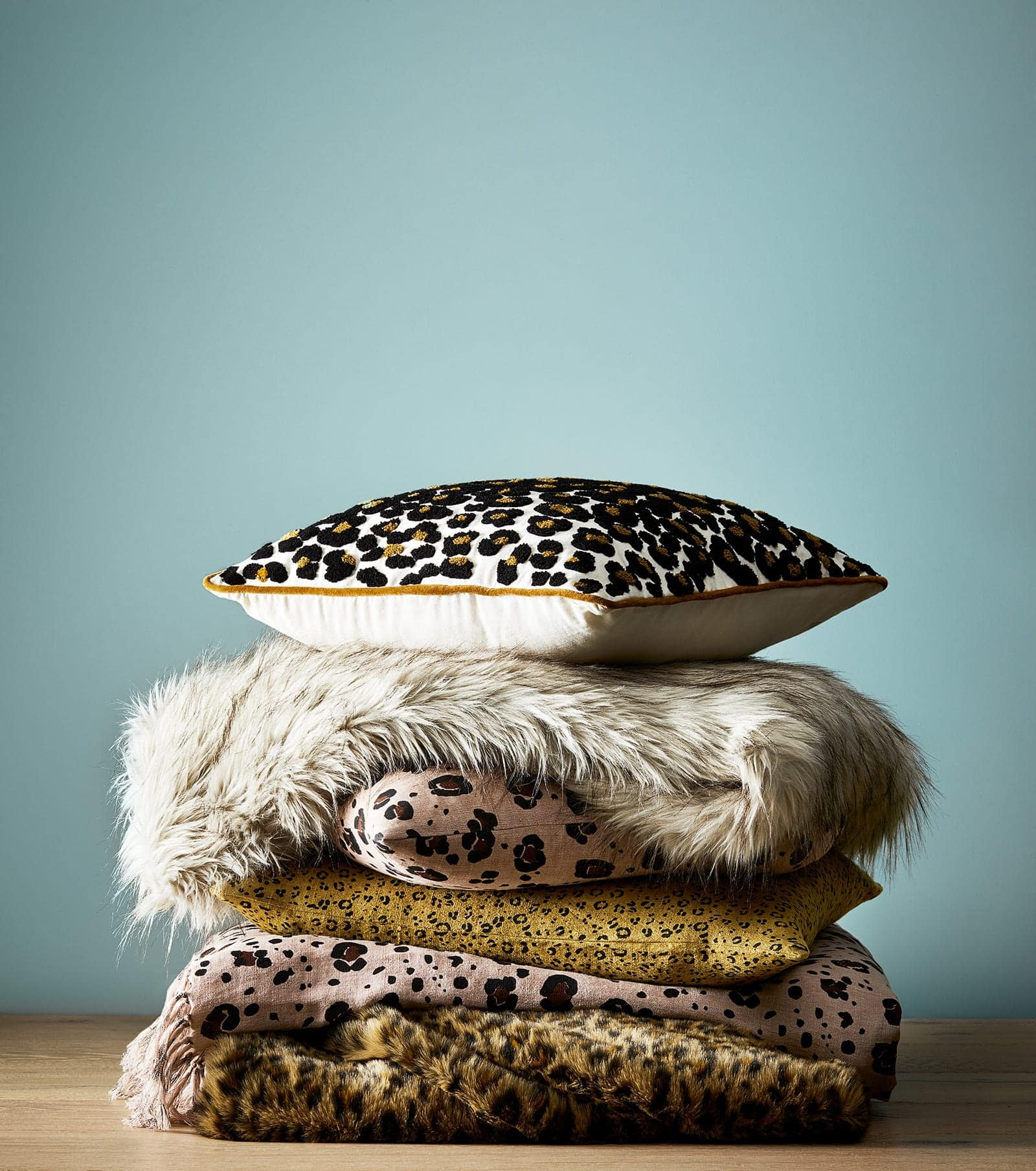 leopard print cushion cover with feather cushion insert from adairs