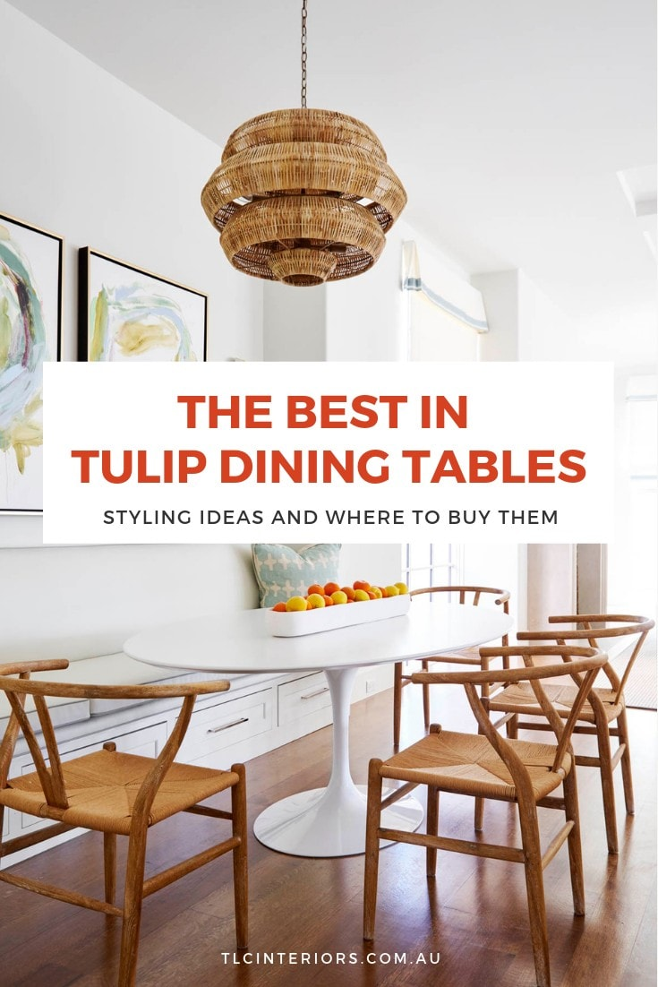 tulip dining table with wishbone chair in dining room with timber flooring