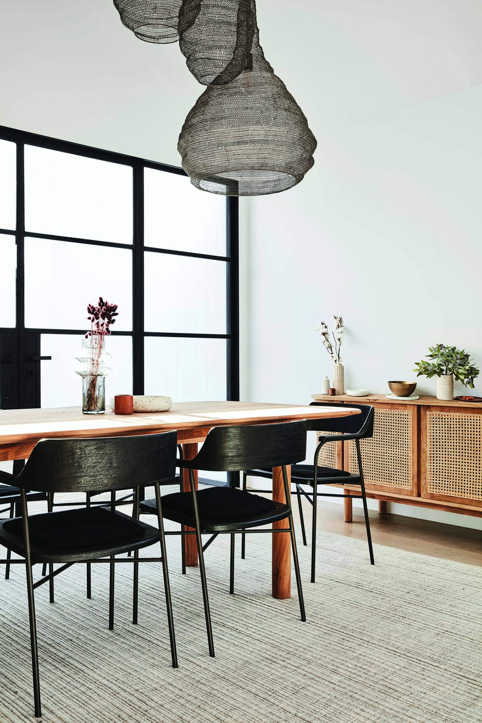 globewest 2020 interior design trends timber dining table with black timber dining chairs and sideboard with mesh front