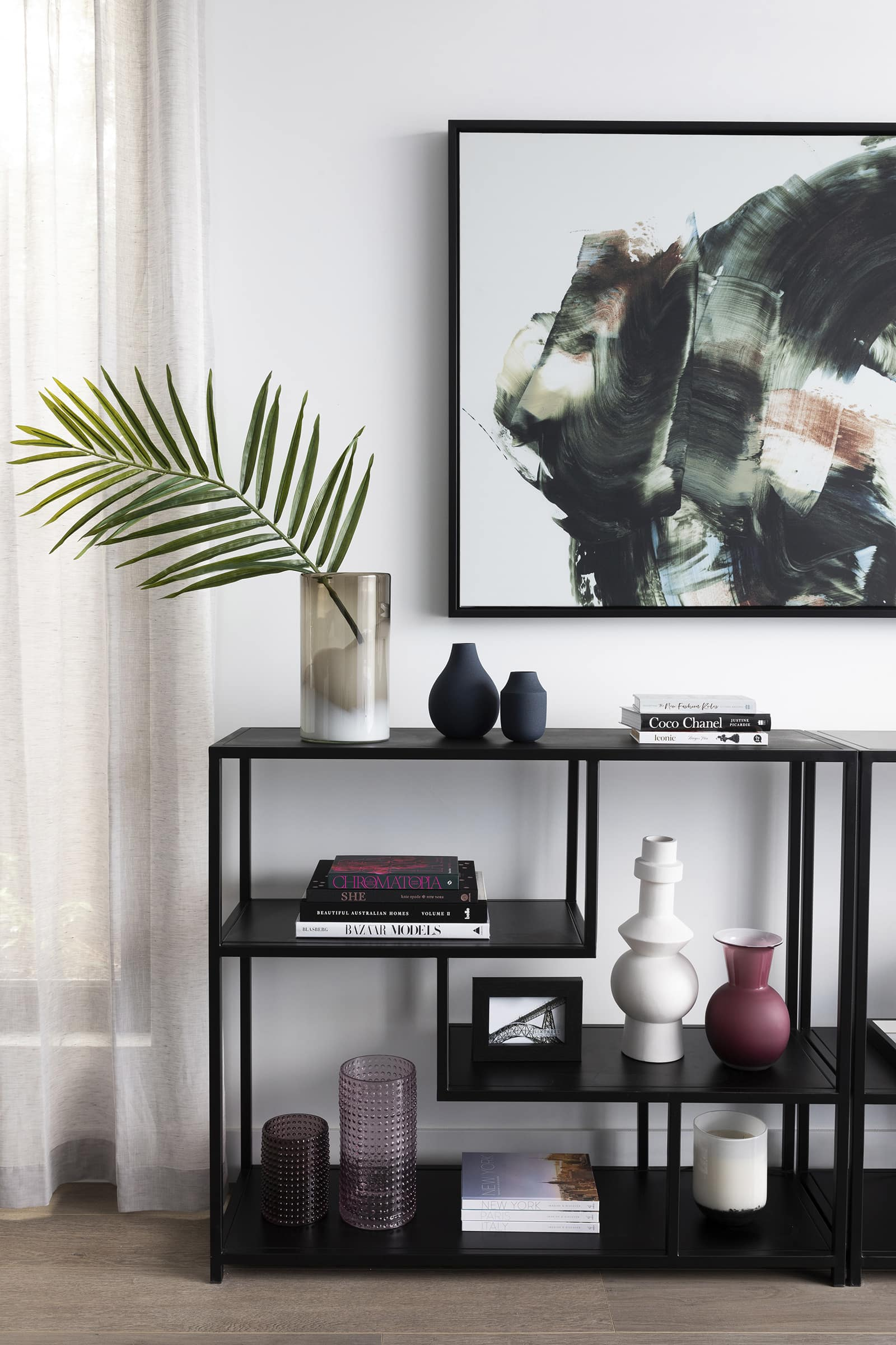 black metal shelf with kmart vases west elm vases and fake plants and sheer curtain