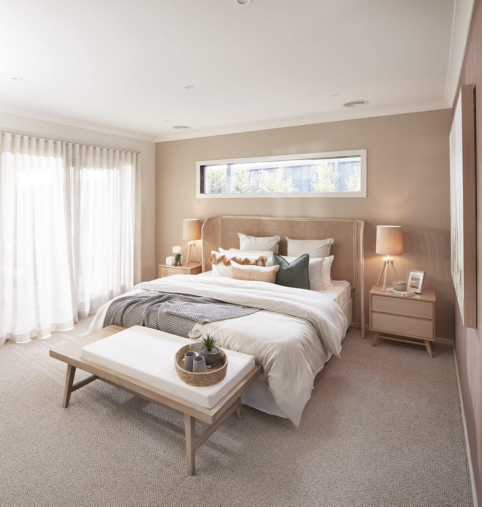 energy efficient home designs bedroom with bohemian headboard and white and beige bedding