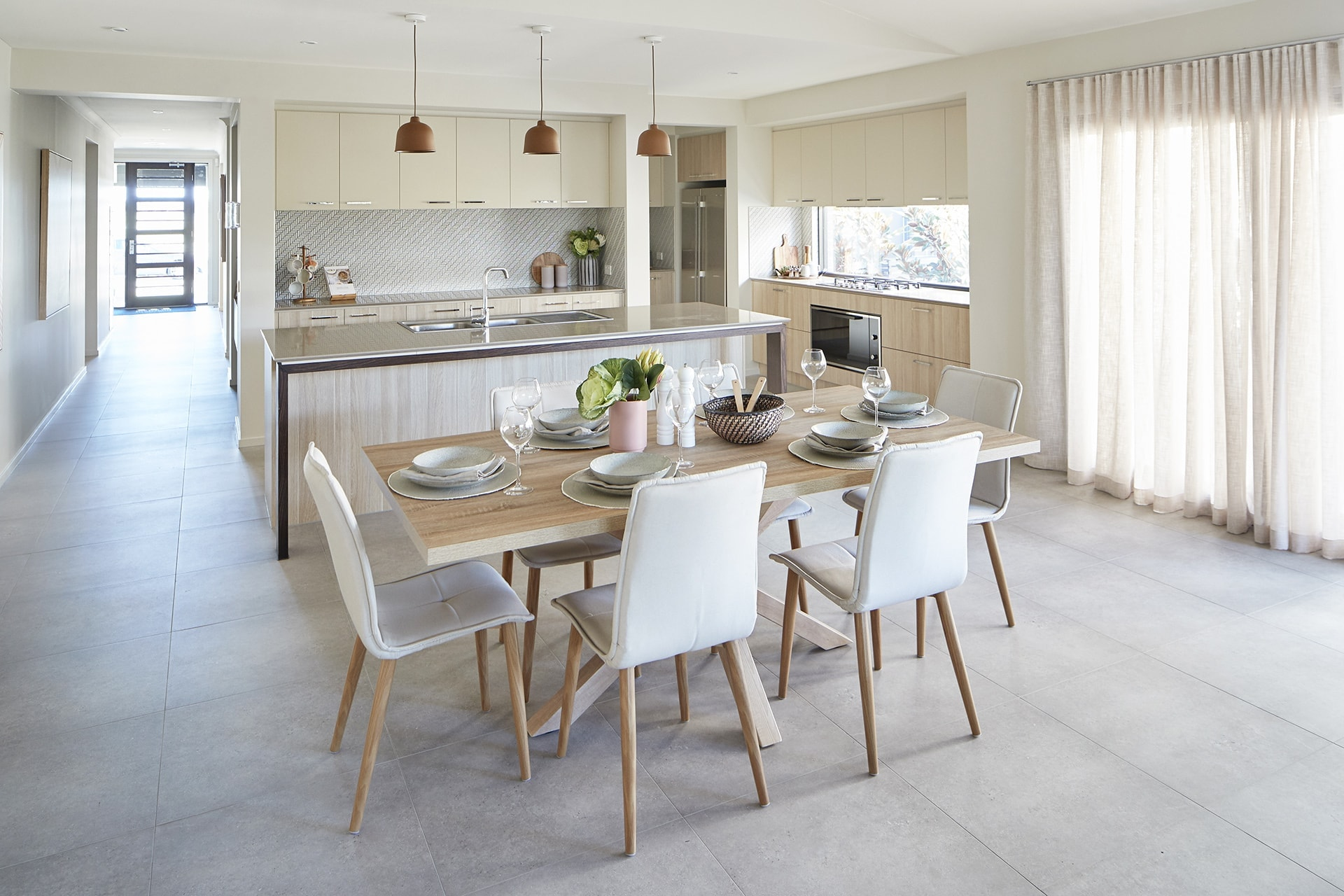 energy efficient home designs dining room with rectangle oak timber table and white dining chairs