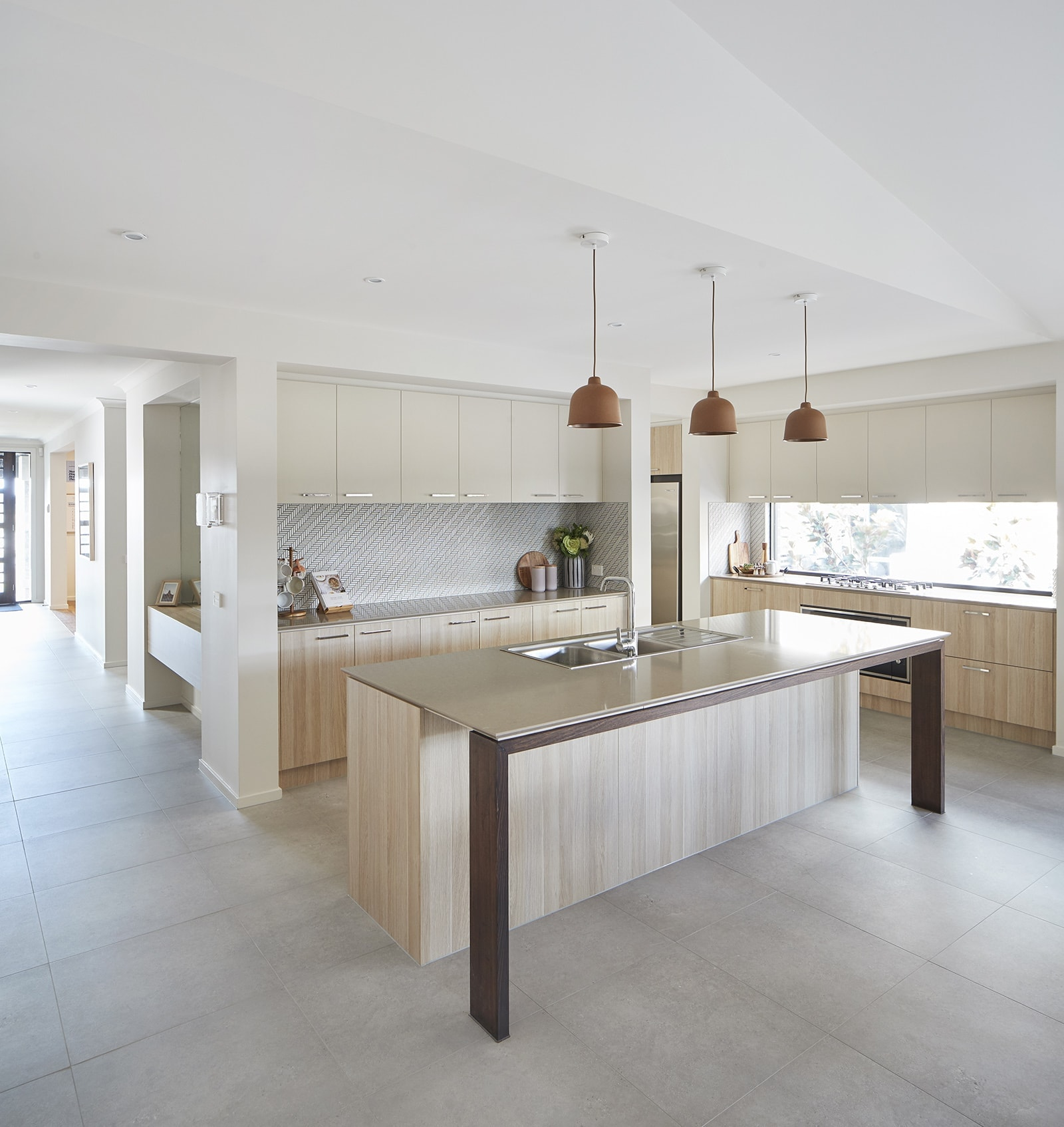 energy efficient home designs kitchen by metricon homes with terracotta pendants